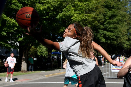 Deven Hunter plays with her team, Back That Pass Up, in the Hoopla 3x3 basketball tournament near the Oregon State Capitol in Salem on Saturday, Aug. 4, 2018.