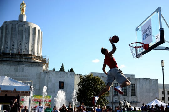 Bryce Clifton, of Portland, competes in the Hoopla Slam Dunk Contest outside the Oregon State Capitol in Salem on Aug. 4, 2018.