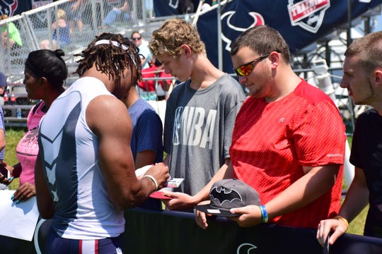 Students from Liberty Point Behavioral Healthcare in Staunton, Va., have their hats and cards autographed during the team's preseason camp on Saturday, Aug. 5, 2018, at the Greenbrier in White Sulphur Springs, W.Va.