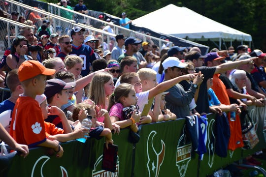 Fans react as they see Houston Texans defensive end J.J. Watt walk on to the field at the team's preseason camp on Saturday, Aug. 5, 2018, at the Greenbrier in White Sulphur Springs, W.Va.