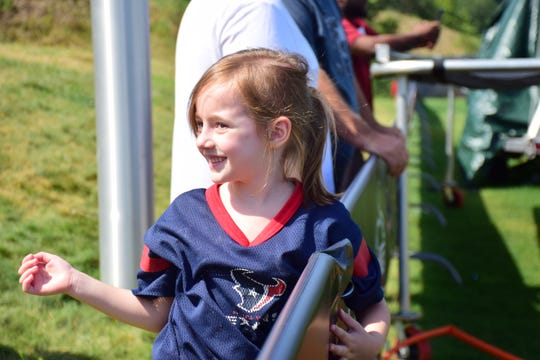 Ava Lefever, 6, of Yorktown, Va., reacts after being waved to by one of the Houston Texans at the team's preseason camp on Saturday, Aug. 5, 2018, at the Greenbrier in White Sulphur Springs, W.Va.