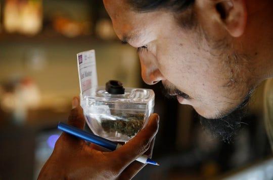 Paul Whiterock smells marijuana for sale at 420 Sahara Wellness in Las Vegas on July 30, 2018.