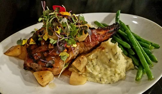 The Gafford's maple-brined double bone pork chop had a stunning presentation. The large chop was adorned by chunks of bourbon smoked apples and salted vanilla caramel pecans and was set atop garlic confit mashed Yukon potatoes.