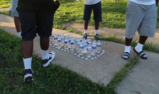 Mourners gather Saturday in a tribute to Ty'mire Selby, 12, who died in an accidental shooting at his home in the Riverside neighborhood of Wilmington on Friday.