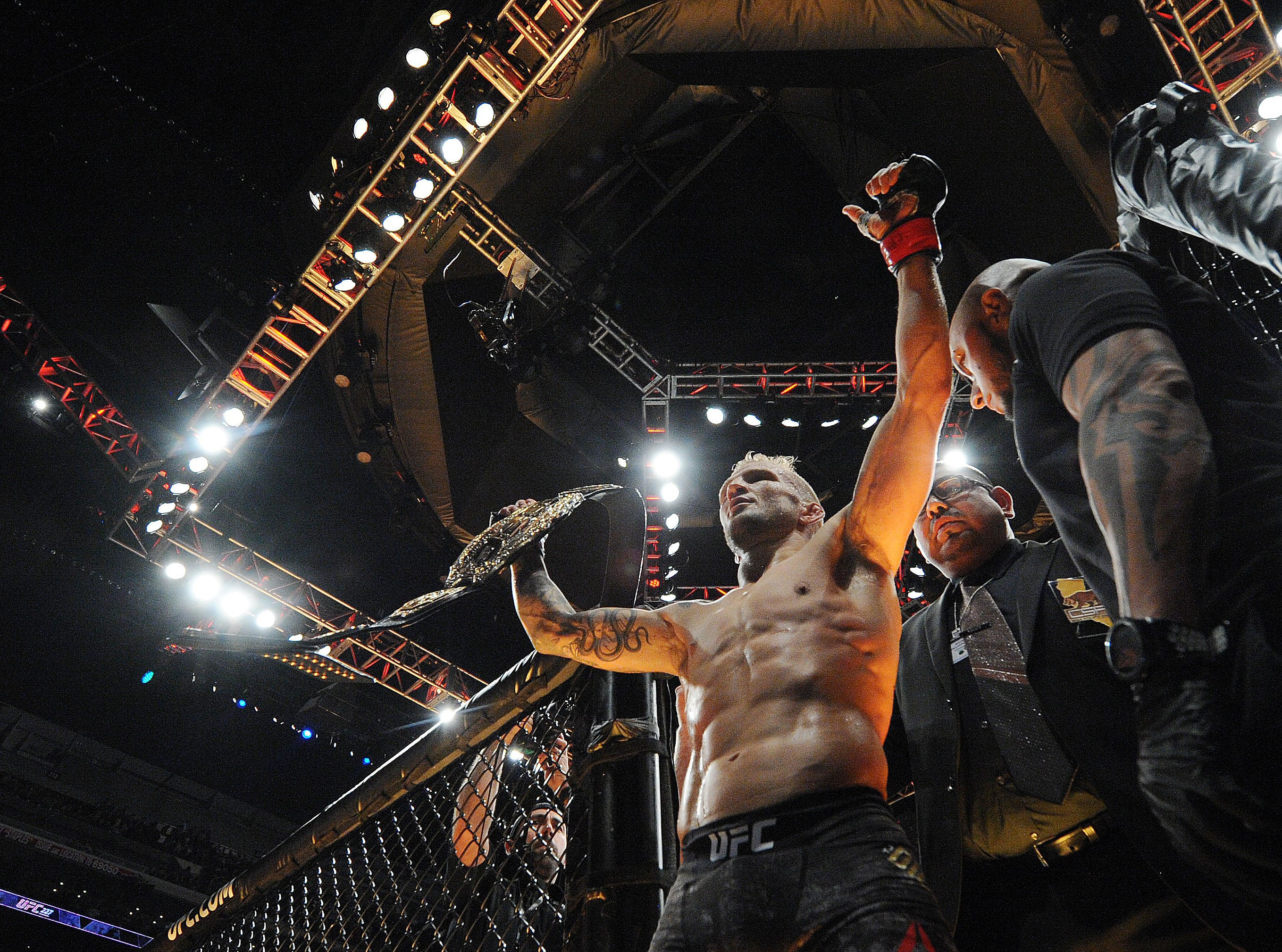 TJ Dillashaw celebrates his championship victory against Cody Garbrandt during UFC 227 at Staples Center.