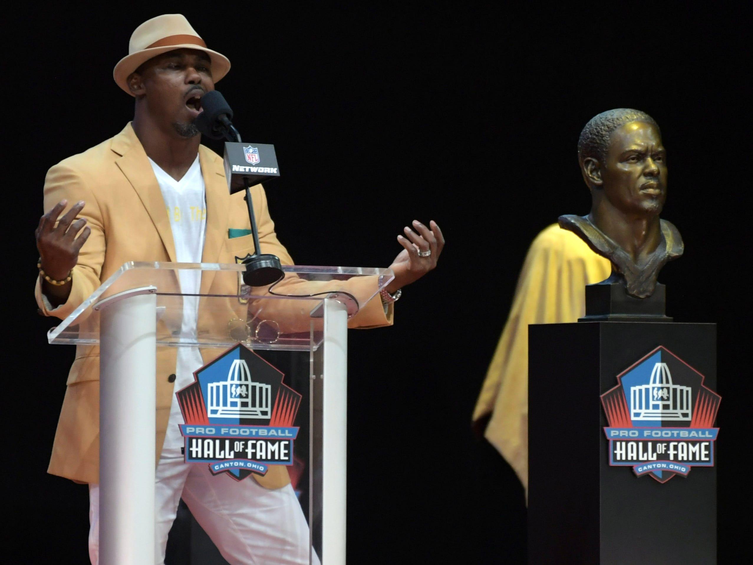 Former Philadelphia Eagles and Denver Broncos safety Brian Dawkins speaks during the Pro Football Hall of Fame Enshrinement Ceremony at Tom Bensen Stadium.
