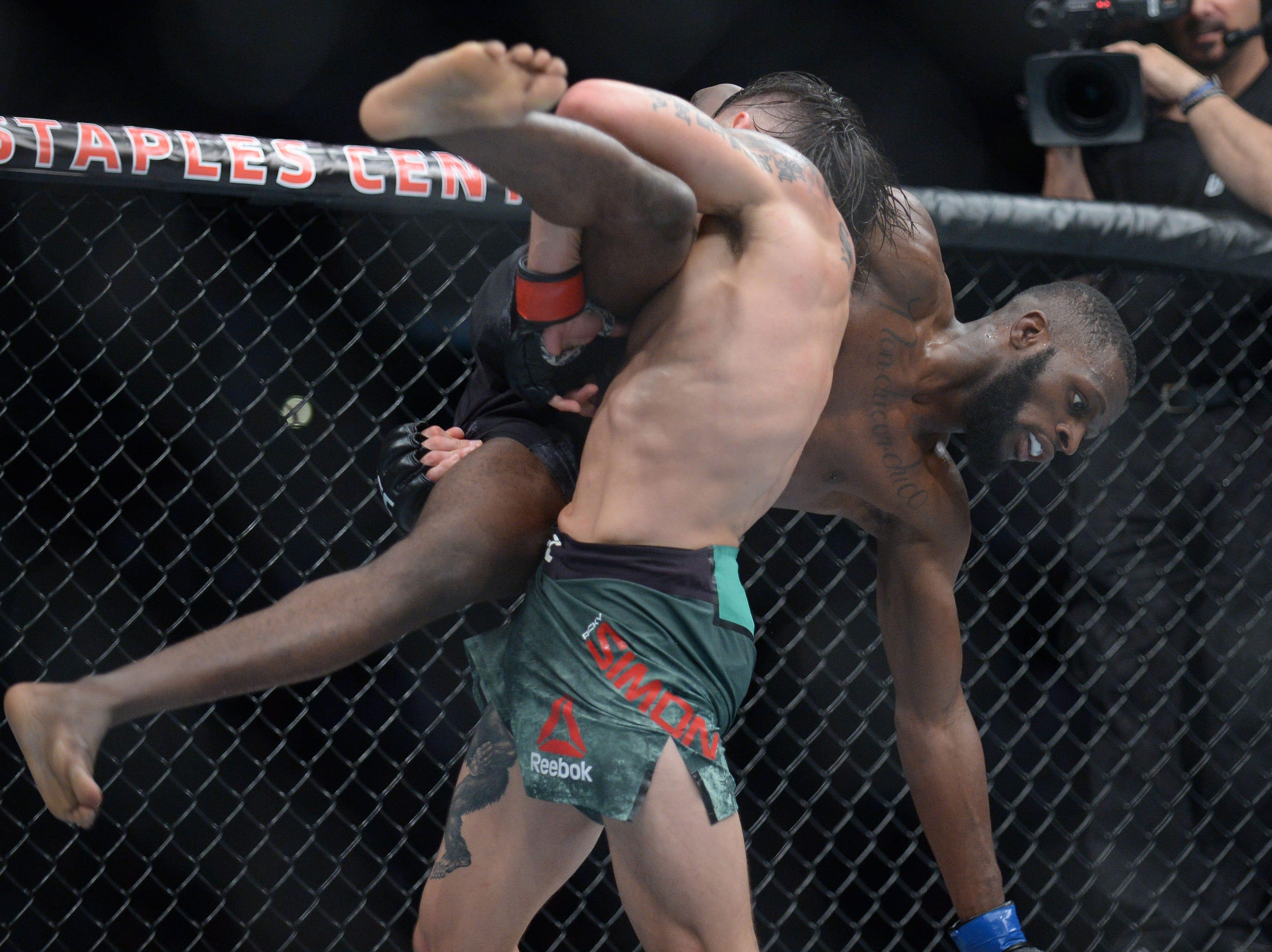Ricky Simon brings down Montel Jackson during UFC 227 at Staples Center.
