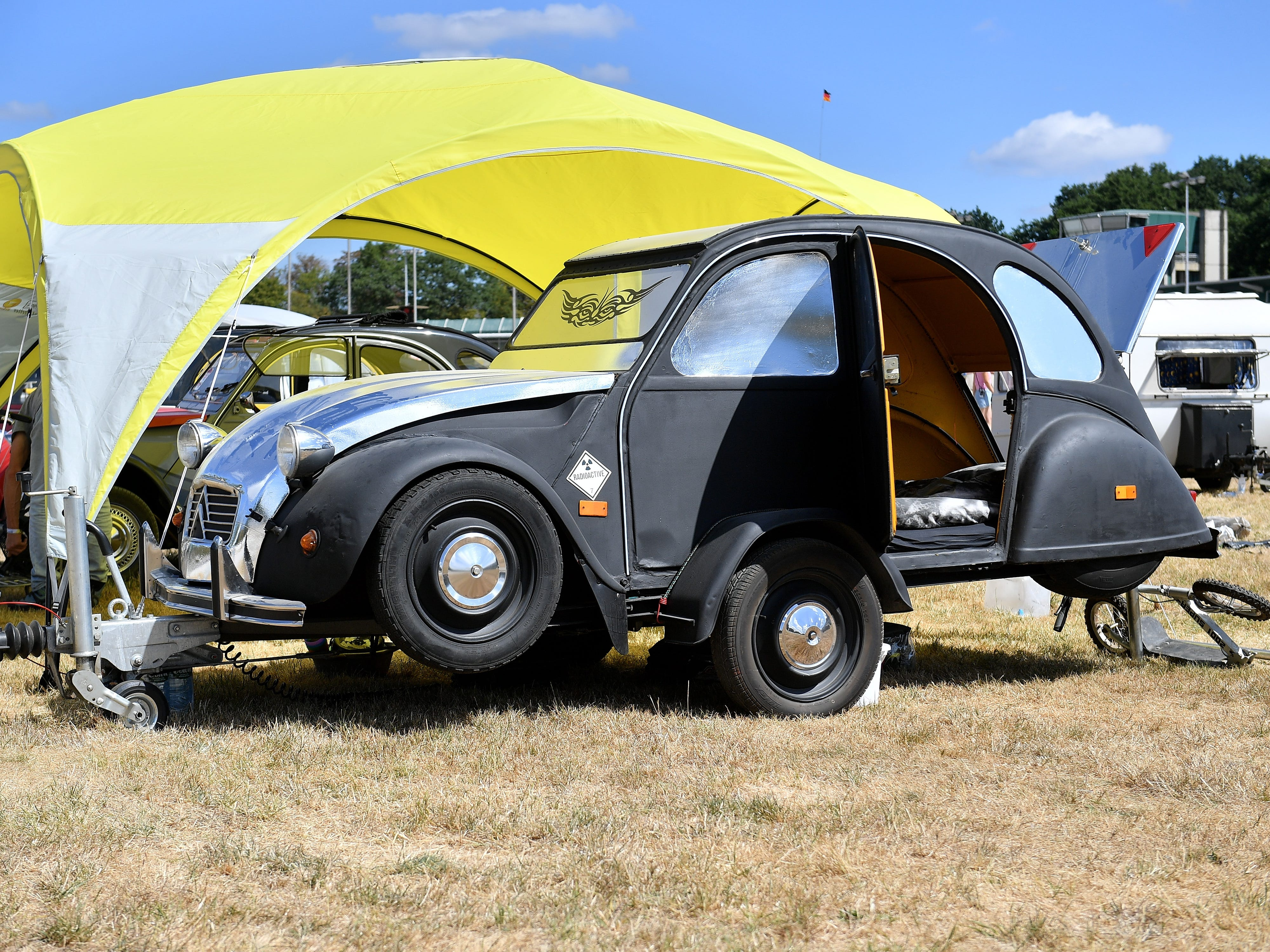 epa06928536 An unusual trailer made of a Citroen 2CV at the 8th International Germany Citroen 2CV meeting at the trotting track in Dinslaken, Germany, 05 August 2018. More than 1,000 fans of the French cult car from many countries, gazed numerous maintained examples of the cult 'duck' in all colours and versions.  EPA-EFE/SASCHA STEINBACH