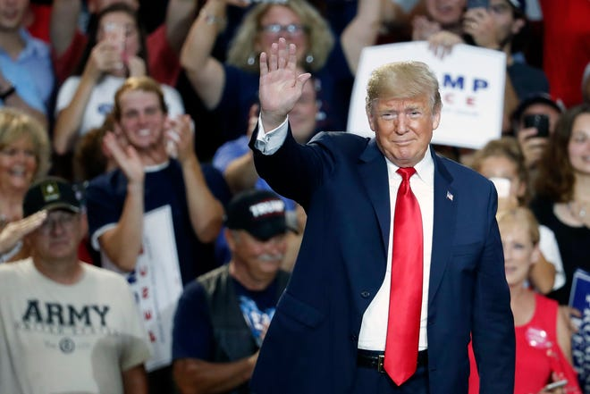 President Donald Trump waves to the crowd during a rally, Saturday, Aug. 4, 2018, in Lewis Center, Ohio.
