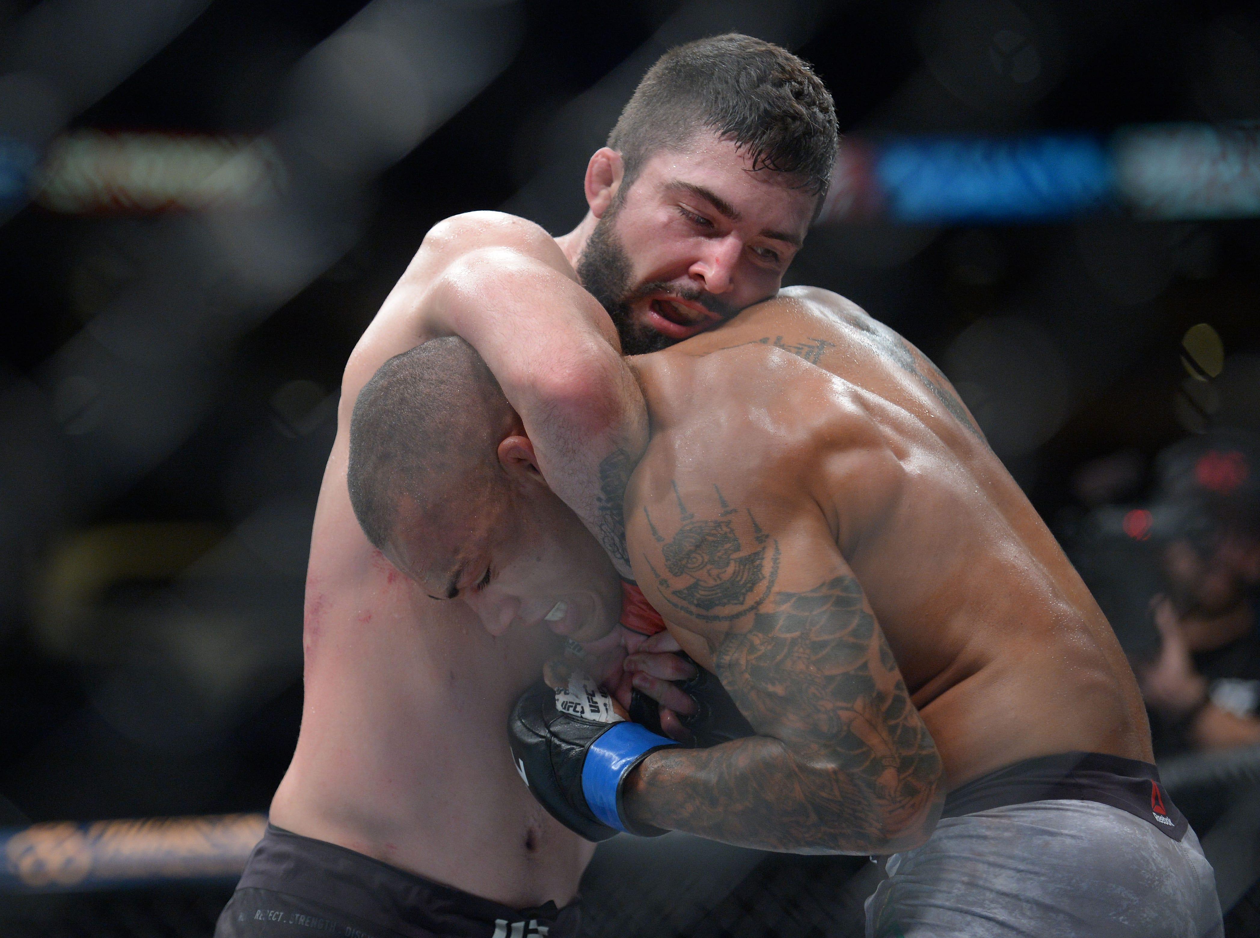 Matt Sayles applies a hold against Sheymon Moreas during UFC 227 at Staples Center.