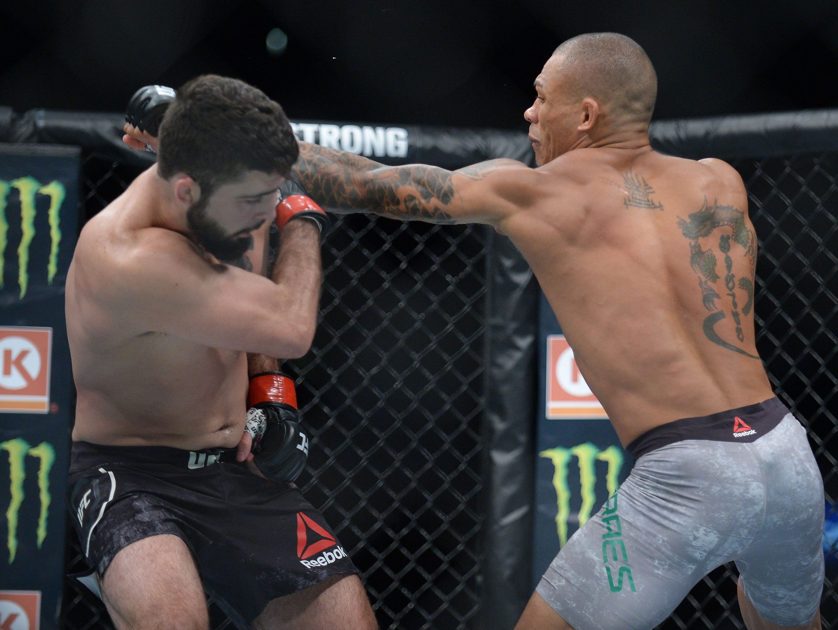 Sheymon Moreas lands a hit against Matt Sayles during UFC 227 at Staples Center.