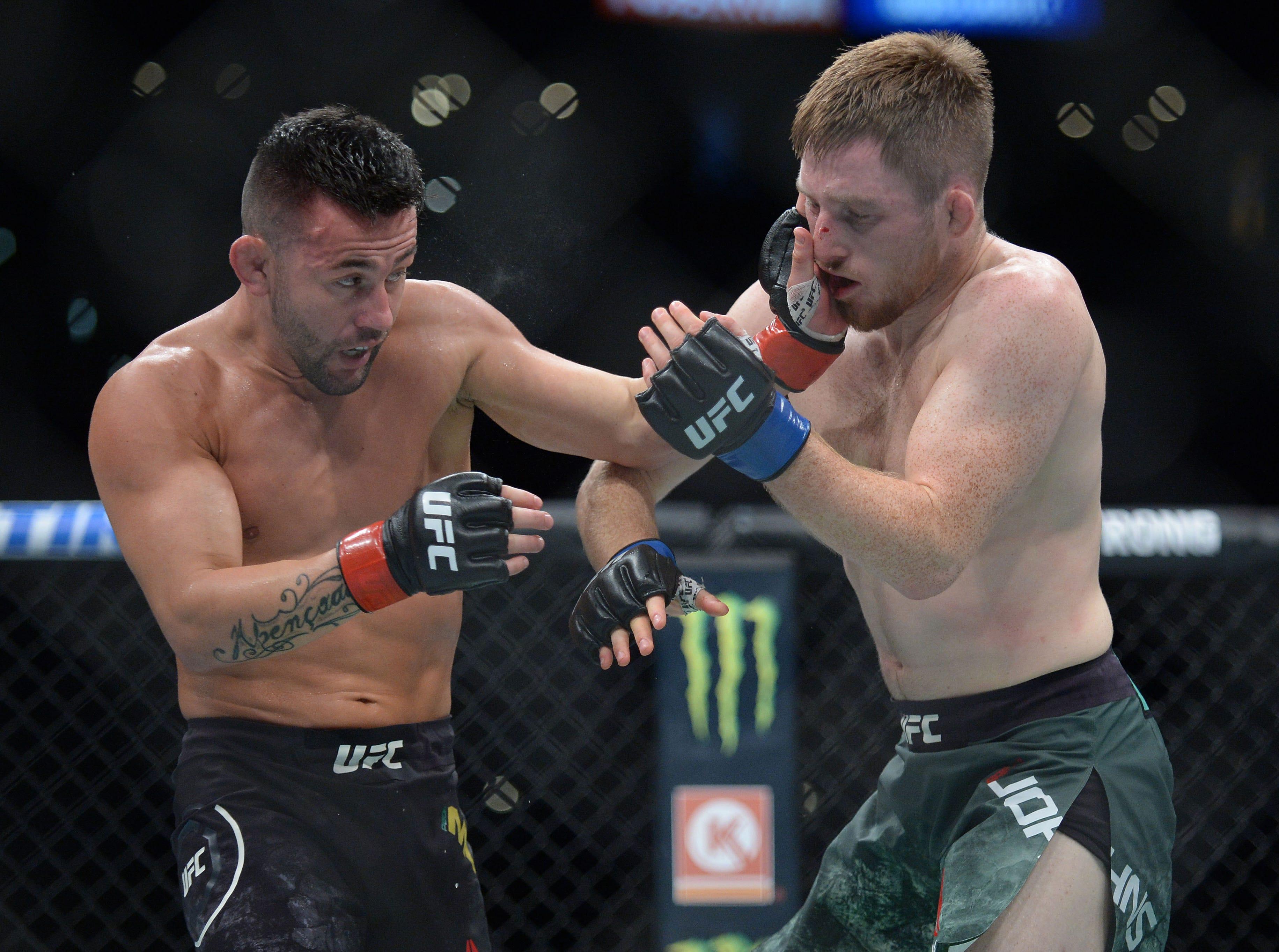 Pedro Munhoz lands a hit against Brett Johns during UFC 227 at Staples Center.