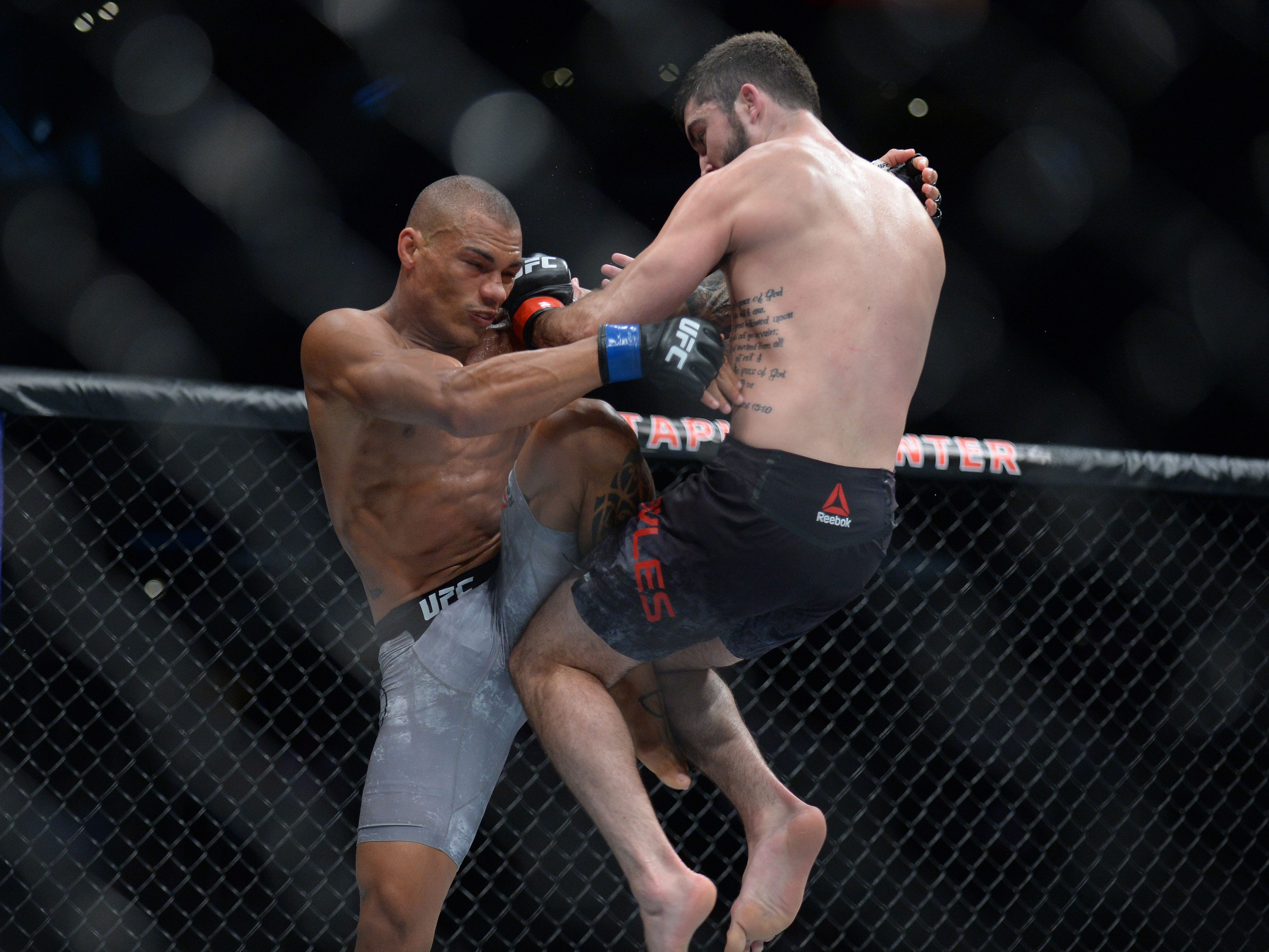 Matt Sayles moves in with a hit against Sheymon Moreas during UFC 227 at Staples Center.