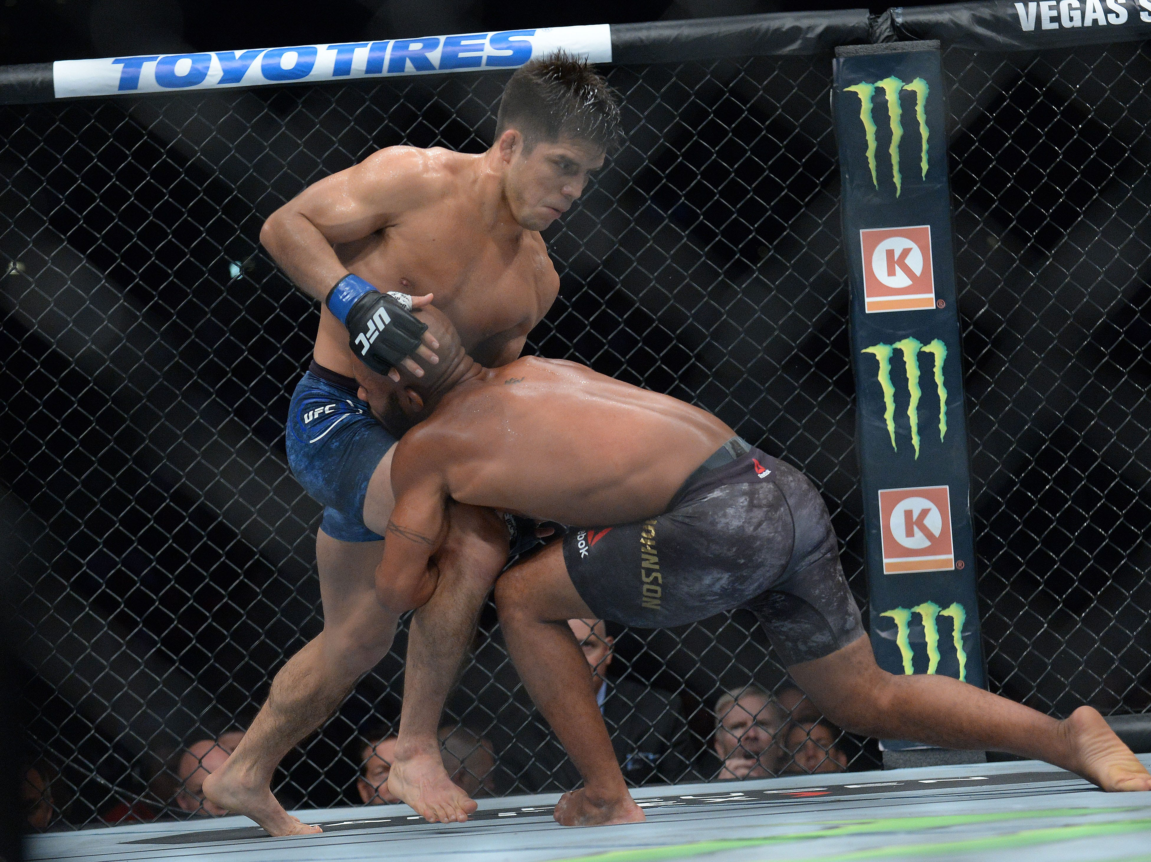 Demetrious Johnson moves in against Henry Cejudo during UFC 227 at Staples Center.