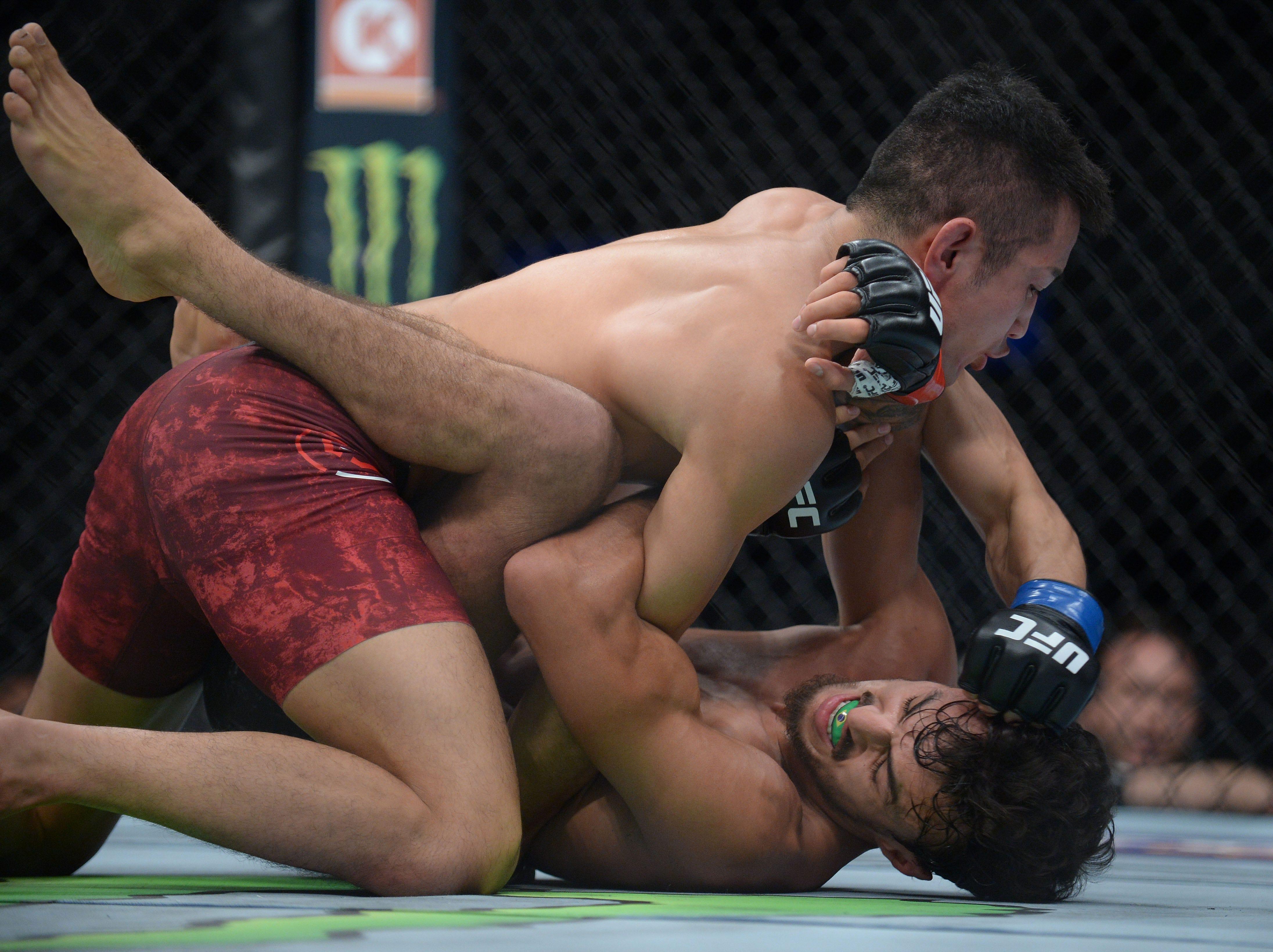 Kyung Ho Kang pins Ricardo Ramos to the mat during UFC 227 at Staples Center.