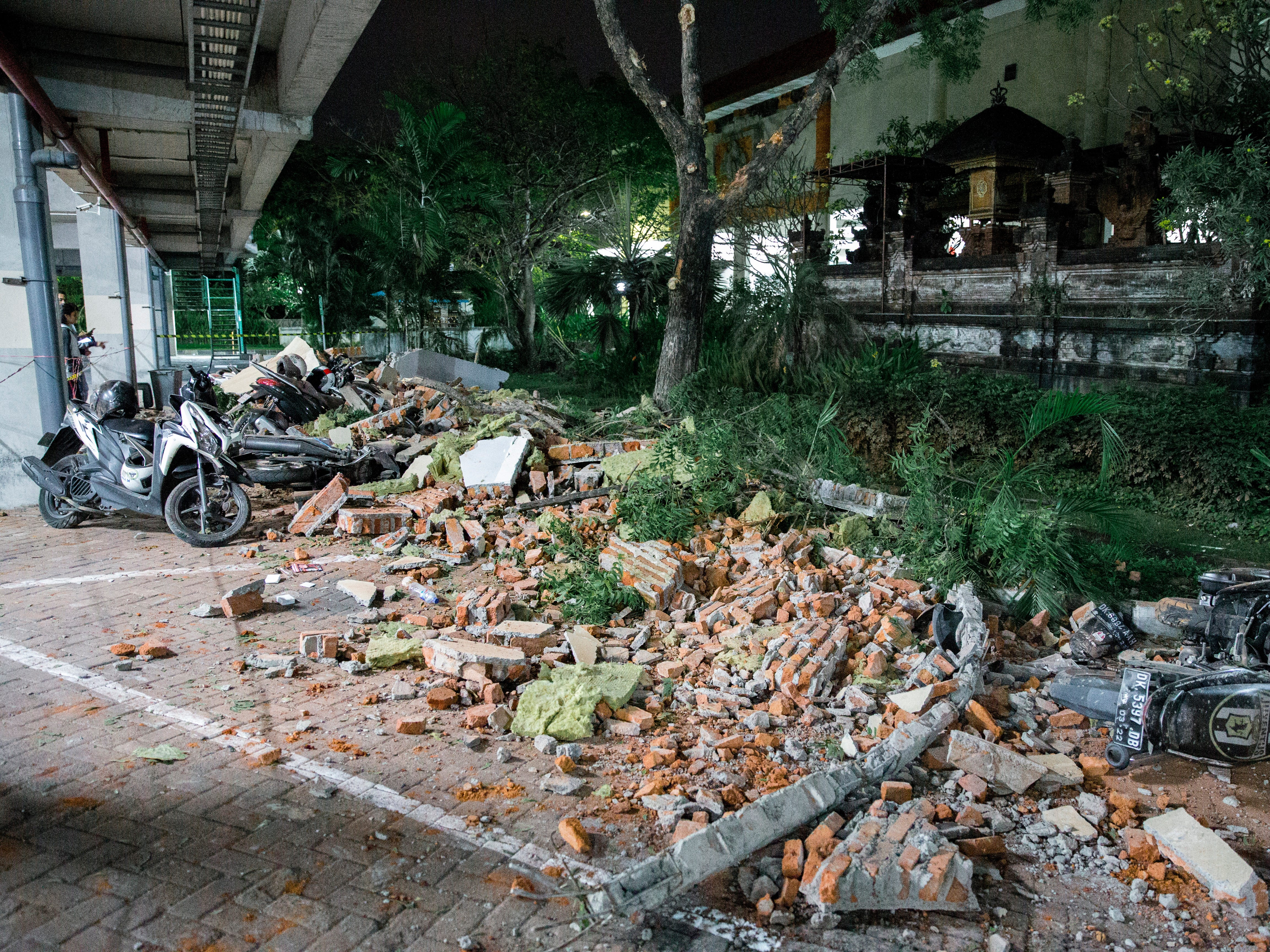 Parts of a shopping mall building collapsed after an earthquake was felt in Denpasar, Bali, Indonesia on Aug. 5 2018.