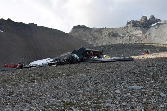 A handout photo made available by Cantonal Police of Grisons shows a wreckege of Junkers JU-52 aircraft after crashing on Piz Segnas above Flims, Switzerland on Aug. 5, 2018.