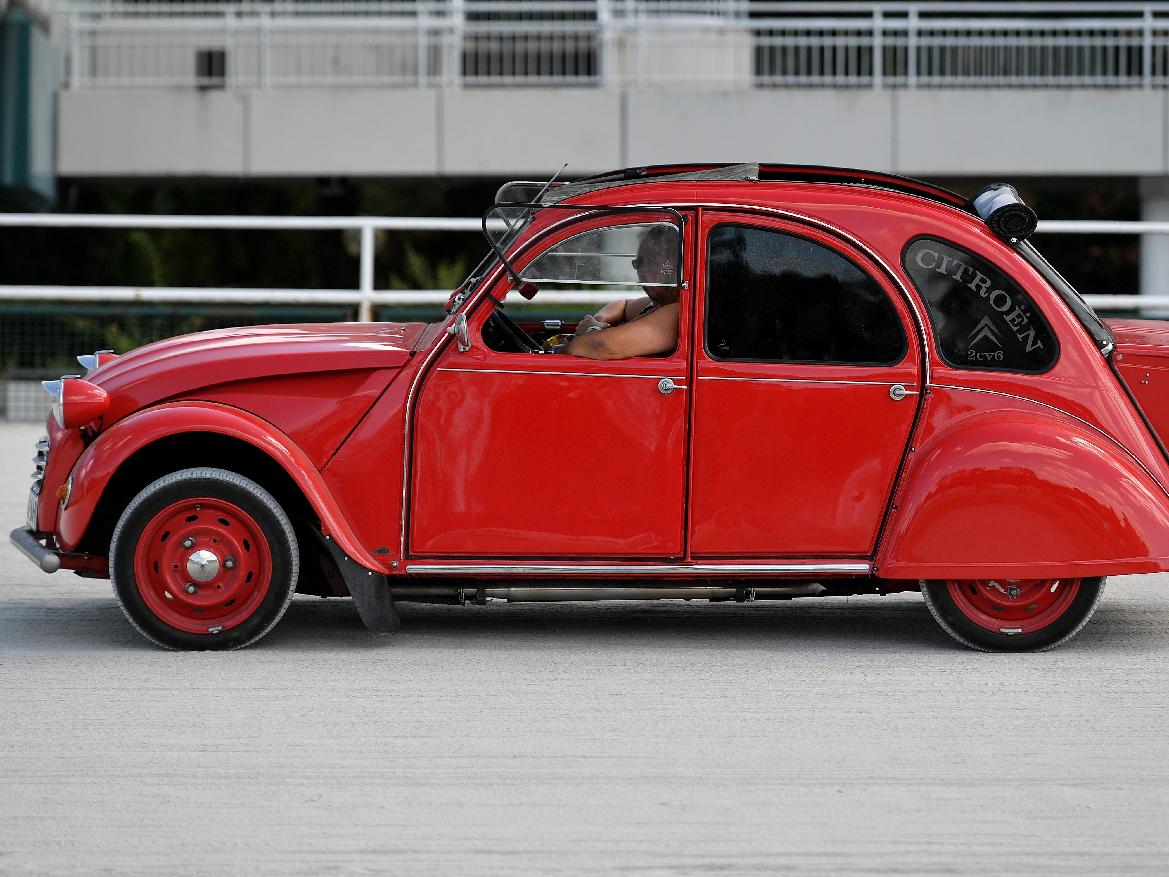 epa06928540 A Citroen 2CV at the 8th International Germany Citroen 2CV meeting at the trotting track in Dinslaken, Germany, 05 August 2018. More than 1,000 fans of the French cult car from many countries, gazed numerous maintained examples of the cult 'duck' in all colours and versions.  EPA-EFE/SASCHA STEINBACH