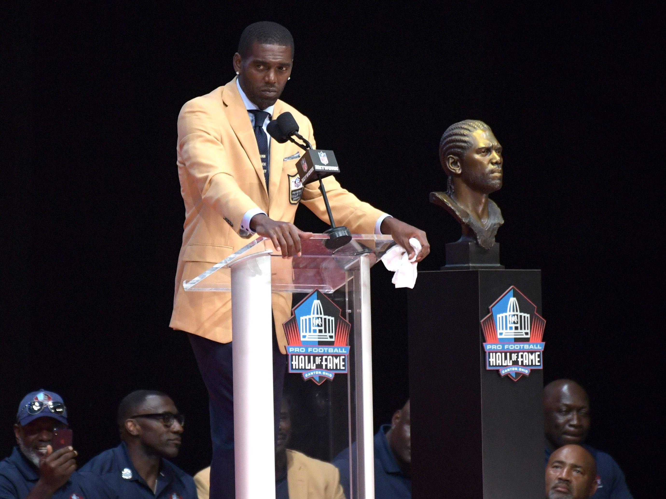 Randy Moss speaks during the Pro Football Hall of Fame Enshrinement Ceremony at Tom Bensen Stadium.
