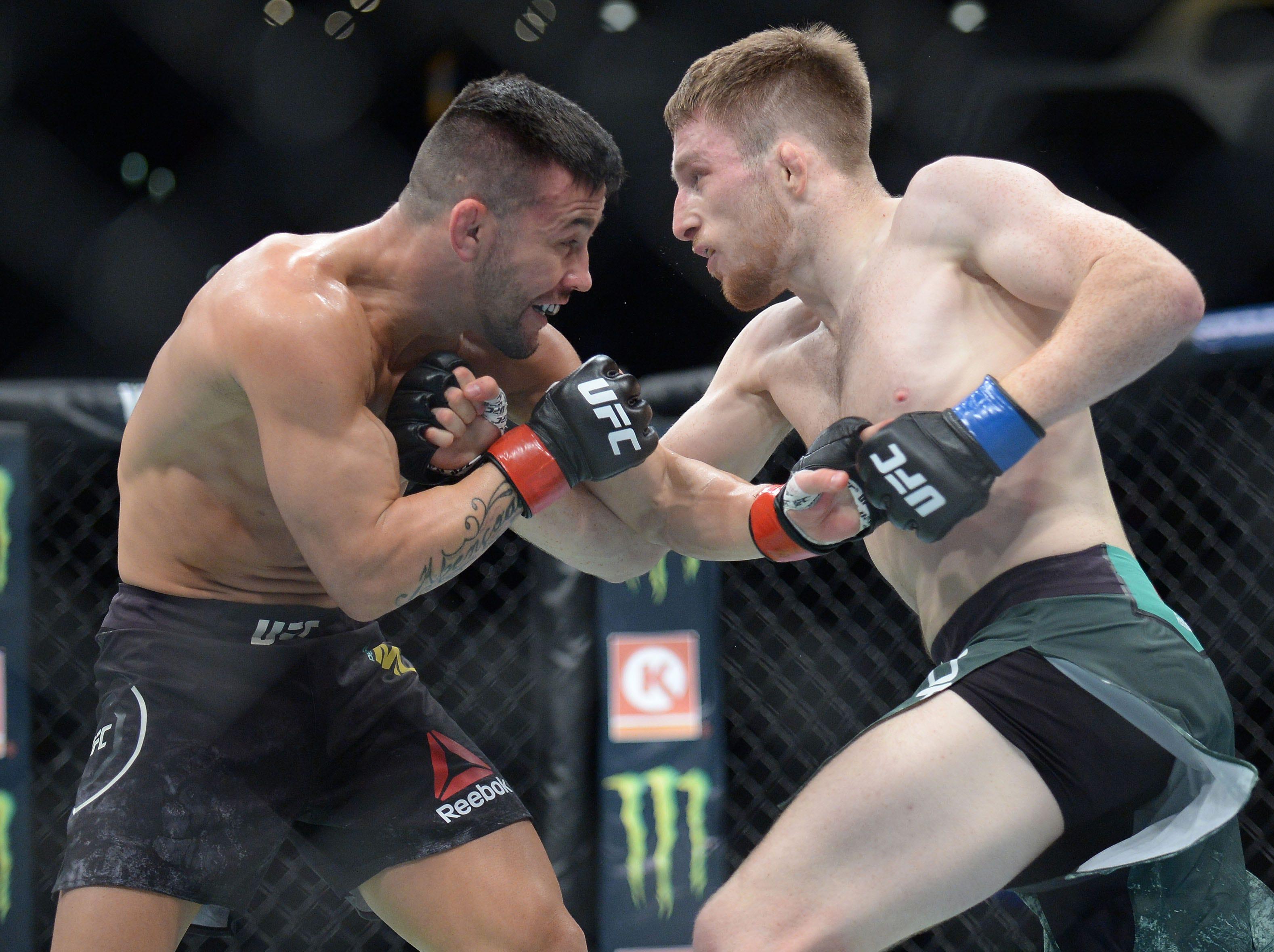 Brett Johns moves in as Pedro Munhoz defends during UFC 227 at Staples Center.
