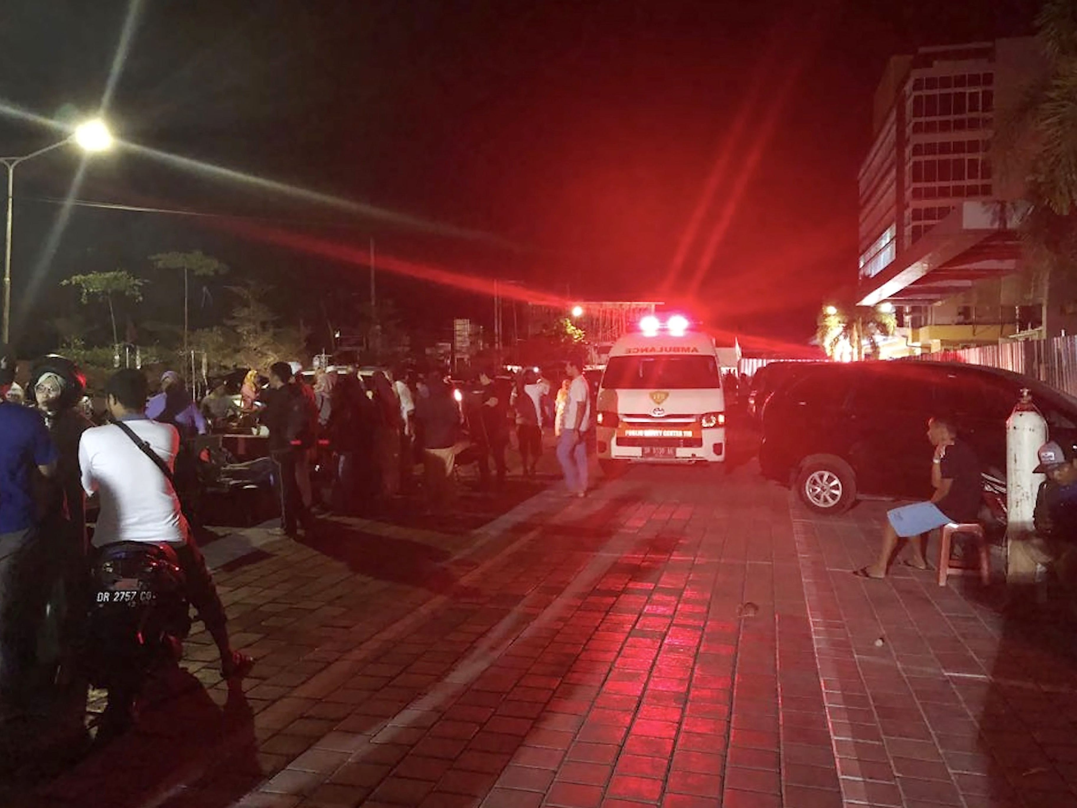 An ambulance rushes out of the hospital after an earthquake rocked Indonesia's Lombok island, in Mataram on August 5, 2018.  A powerful earthquake rocked Indonesia's Lombok on Aug. 5, sending people running from their homes and triggering a tsunami alert, just a week after a quake killed 17 people on the holiday island. The latest tremor had a magnitude of seven and struck just 10 km underground according to the US Geological Survey. It was followed by two aftershocks.