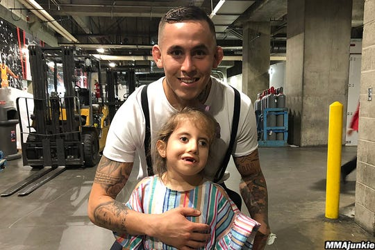 Marlon Vera with his 7-year-old daughter, Ana Paula.