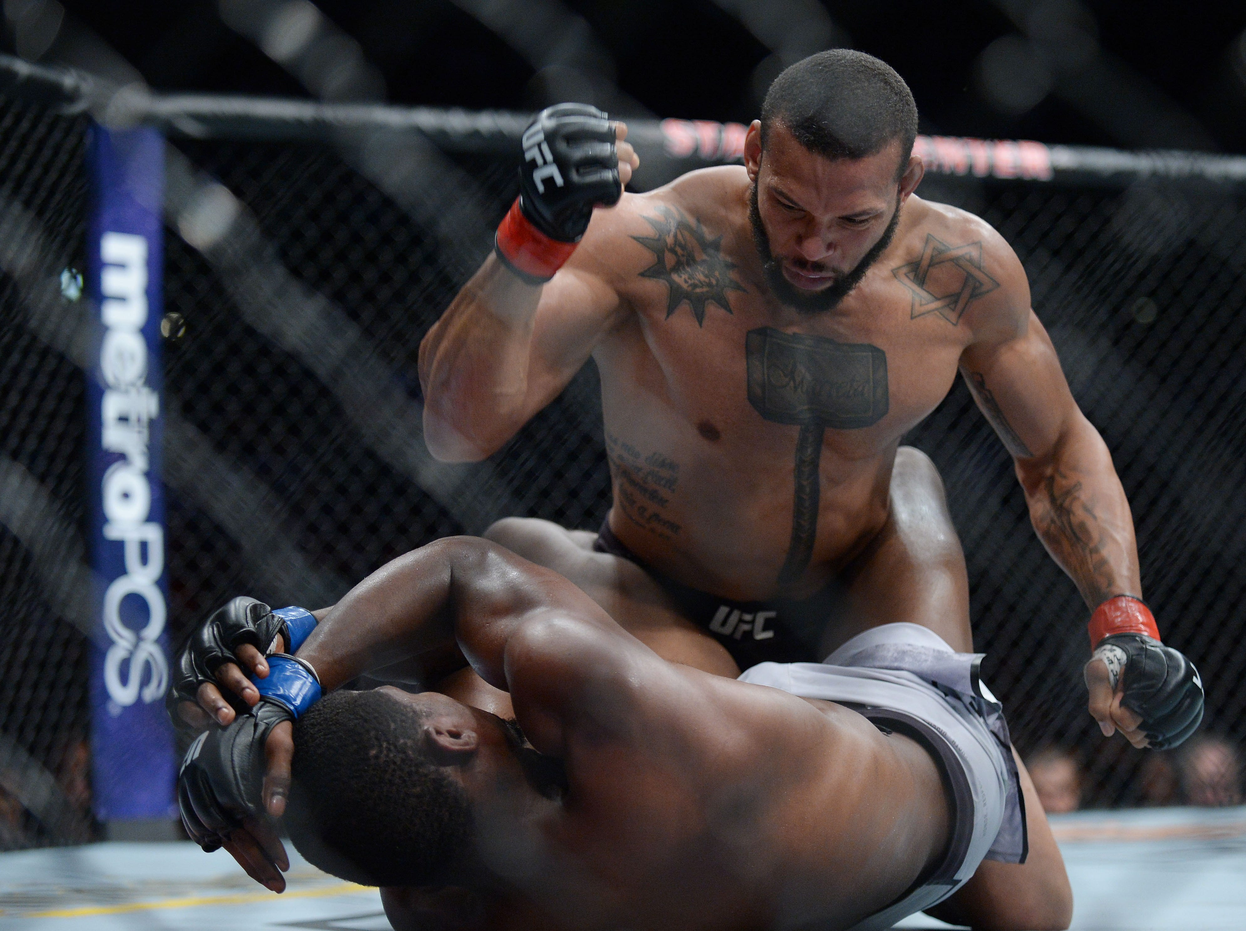 Thiago Santos lands hits against Kevin Holland during UFC 227 at Staples Center.