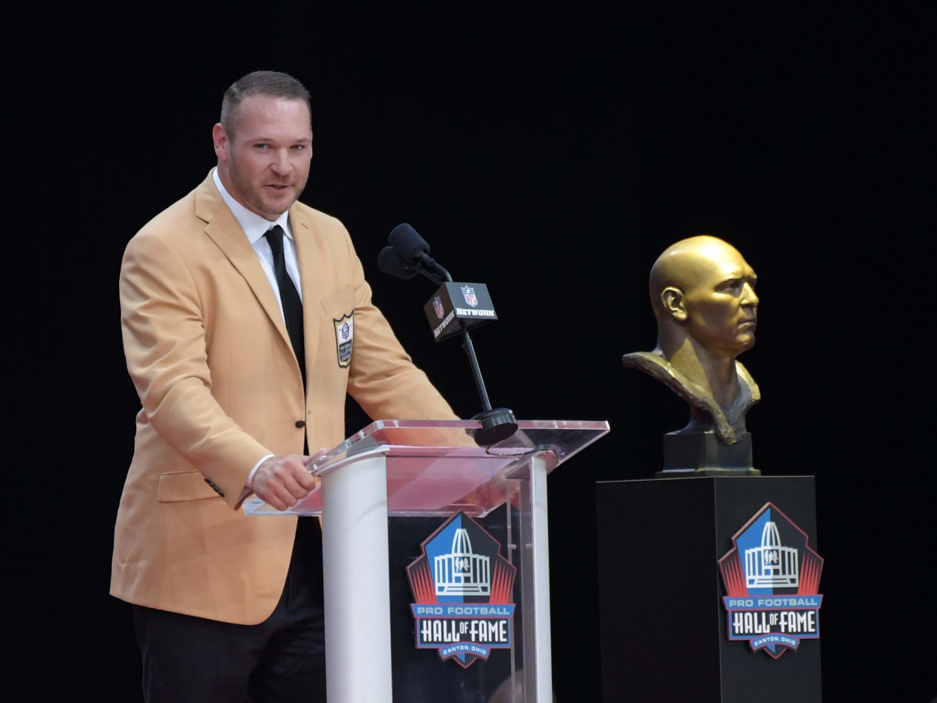Former Chicago Bears linebacker Brian Urlacher speaks during the Pro Football Hall of Fame Enshrinement Ceremony at Tom Bensen Stadium.