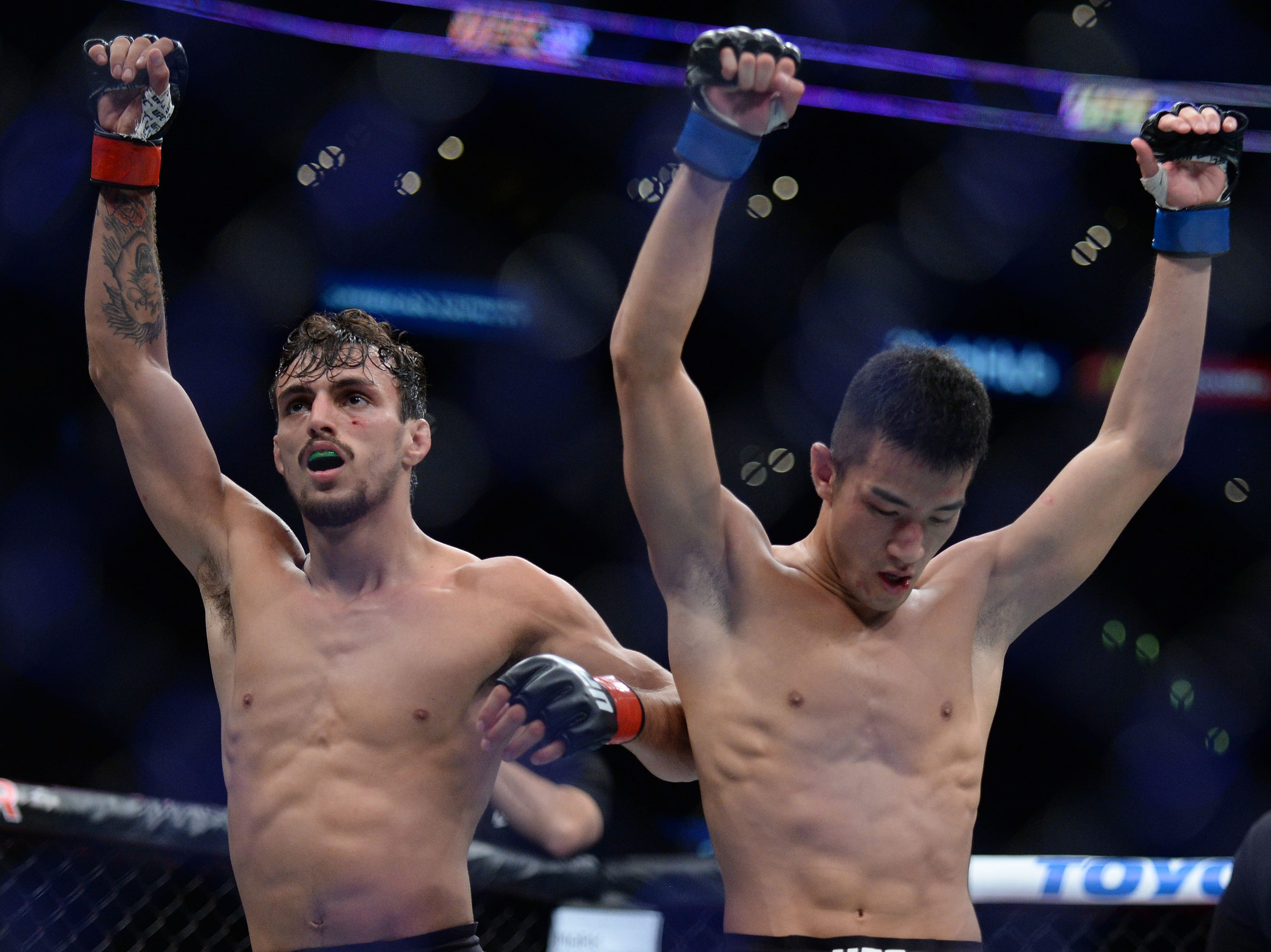 Ricardo Ramos and Kyung Ho Kang following their match during UFC 227 at Staples Center.