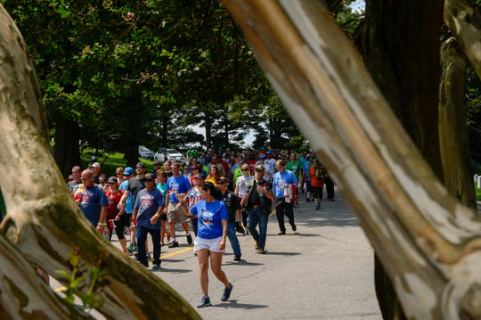 8/5/18 12:46:31 PM -- Arlington , VA, U.S.A  -- *** Arlington Closing Ceremony Day ***Participants walk through Arlington Cemetery in the final mile to section 60 for America's Run For The Fallen. --    Photo by Camille Fine, USA TODAY Staff --    Photo by Camille Fine, USA TODAY Staff ORG XMIT:  CF 137349 Arlington Closin 8/5/2018 [Via MerlinFTP Drop]