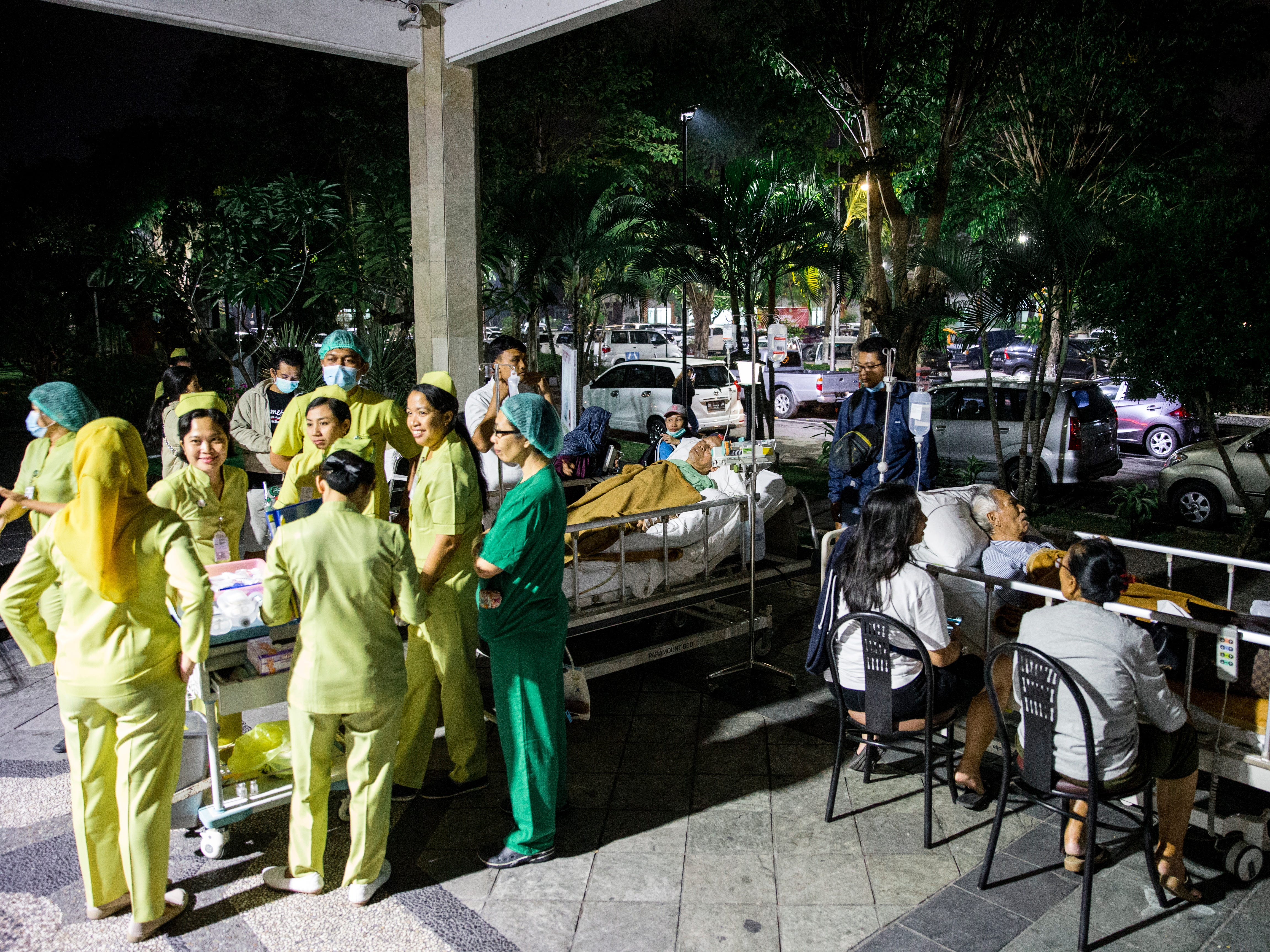 Hospital patients are moved outside of the hospital building after an earthquake was felt in Denpasar, Bali, Indonesia on Aug. 5, 2018.