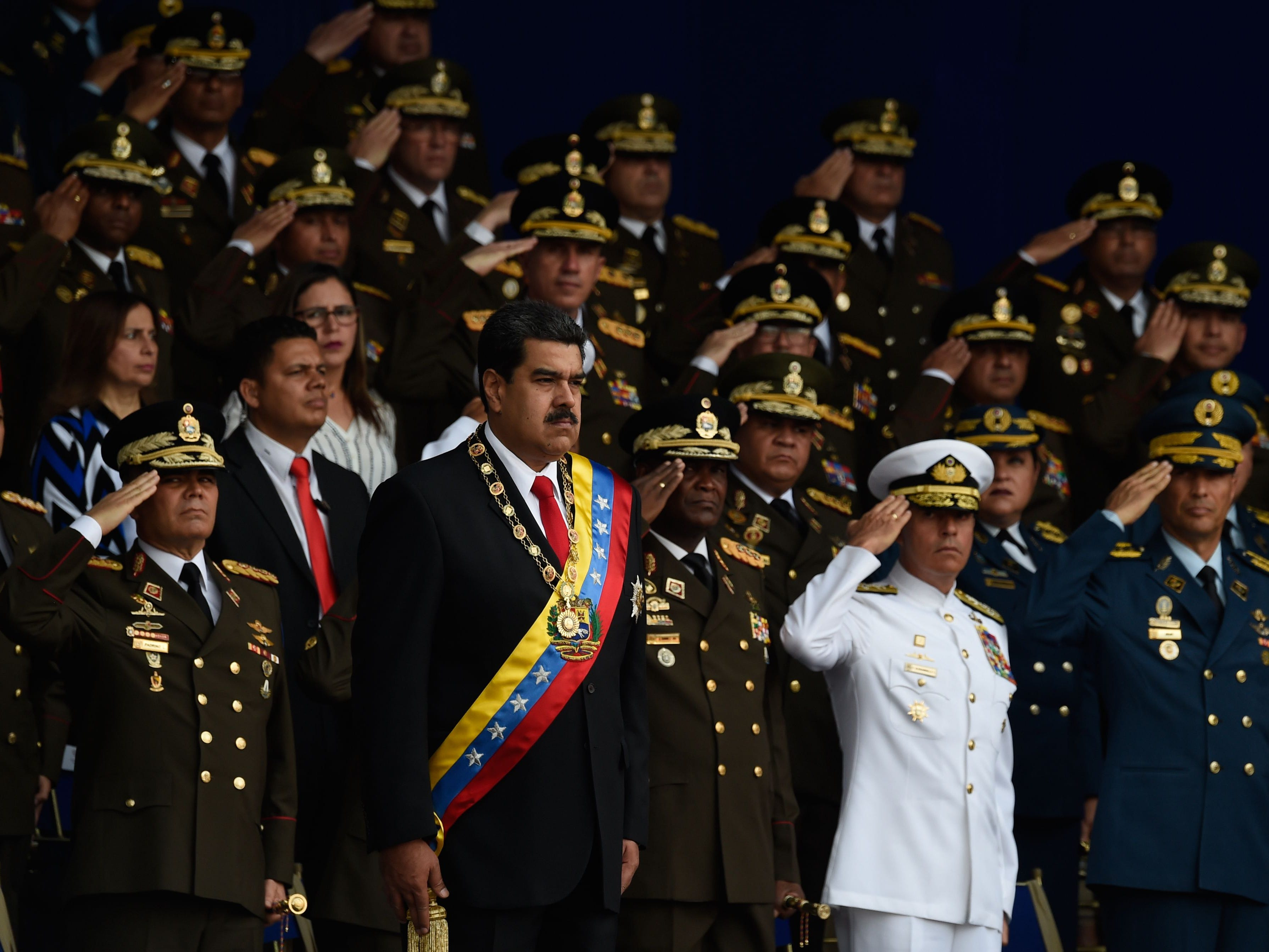 Venezuelan President Nicolas Maduro, center, attends a ceremony to celebrate the 81st anniversary of the National Guard in Caracas on Aug. 4, 2018. A loud bang interrupted Maduro's speech during the military ceremony.
