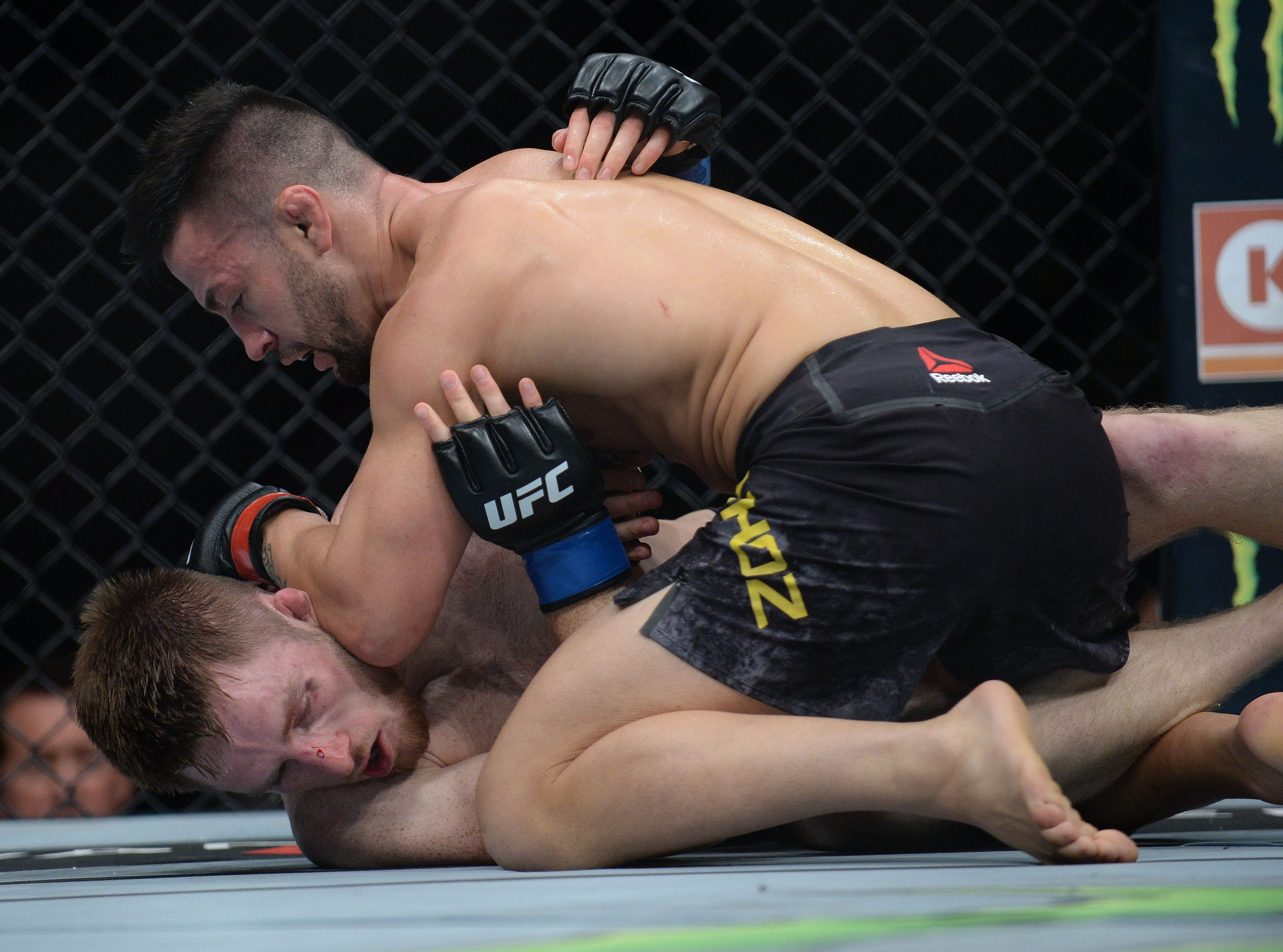 Pedro Munhoz pins Brett Johns to the mat during UFC 227 at Staples Center.