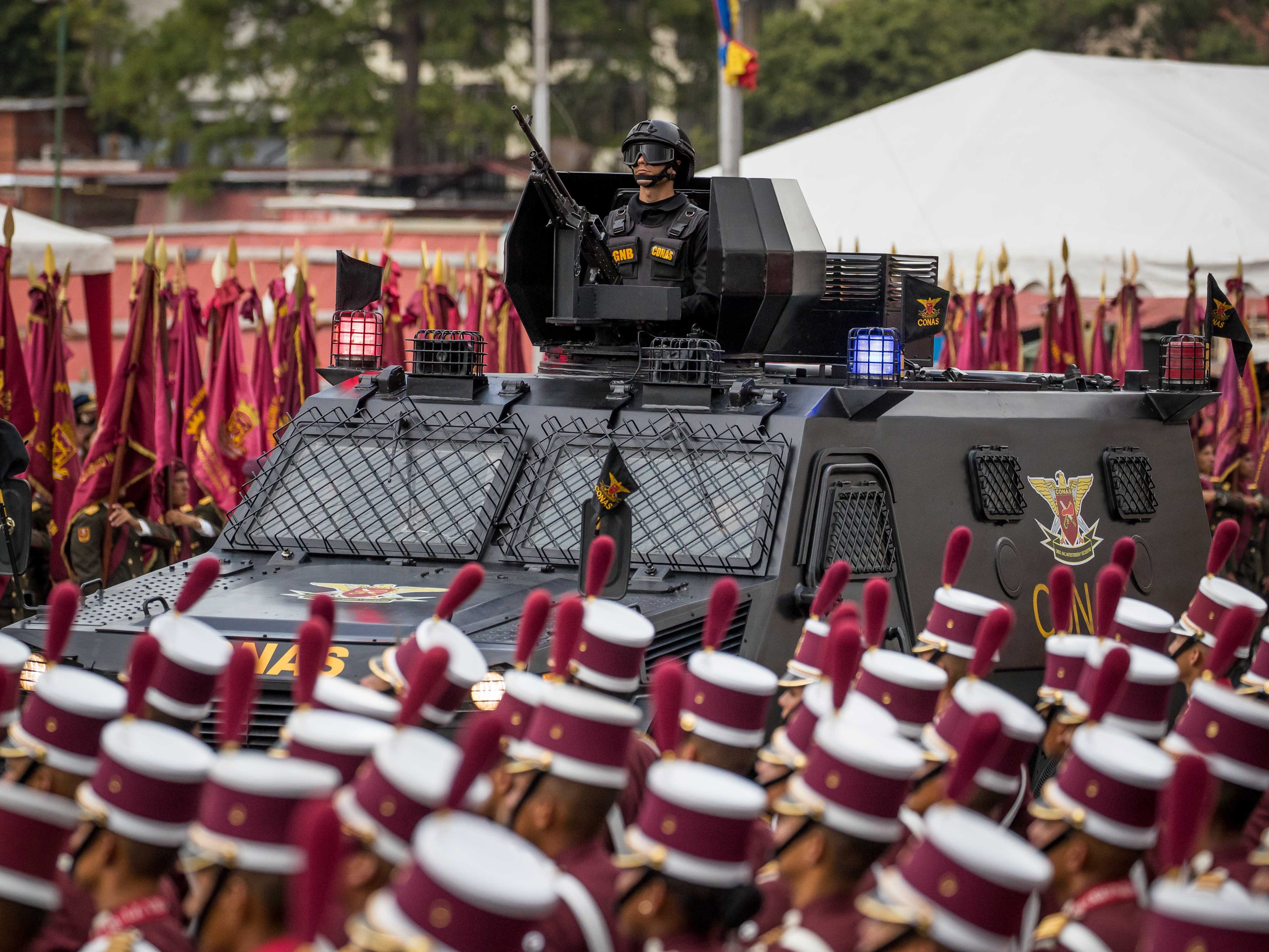 Venezuelan military participates in a televised event with soldiers in Caracas, Venezuela on Aug. 4, 2018. During a commemoration of the 81th anniversary of the creation of the Bolivarian National Guard (GNB) Venezuelan President Nicolas Maduro cut short a speech and was reportedly evacuated. Some witnesses reported explosions as soldiers at the presentation scattered. In a statement to the media after the incident Maduro claimed that Colombian President Juan Manuel Santos and far-right elements in Venezuela had attempted to assassinate him using a pair of drones flying over a military ceremony. The resulting explosion were reported to have injured seven people.