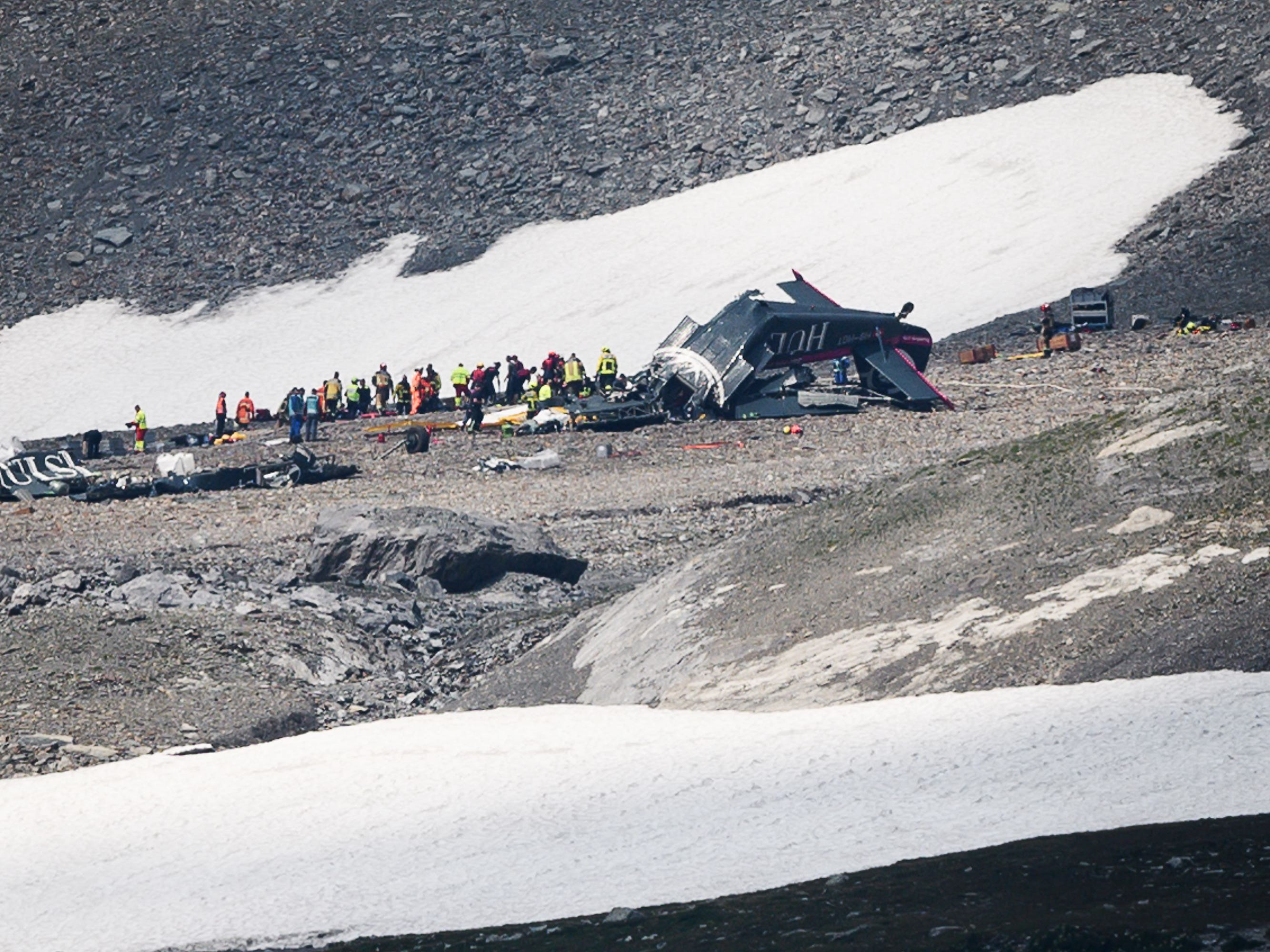 Accident investigators and rescue personnel work at the wreckage of a Junkers JU52 aircraft in Flims on Aug. 5, 2018, after it crashed into Piz Segnas, a 10,000-foot peak in eastern Switzerland on Aug. 4. Twenty people are confirmed dead after a vintage World War II aircraft crashed into a Swiss mountainside, police reports said. The Junker JU52 HB-HOT aircraft, built in Germany in 1939 and now a collectors item, belongs to JU-Air, a company with links to the Swiss air force, the ATS news agency reported.