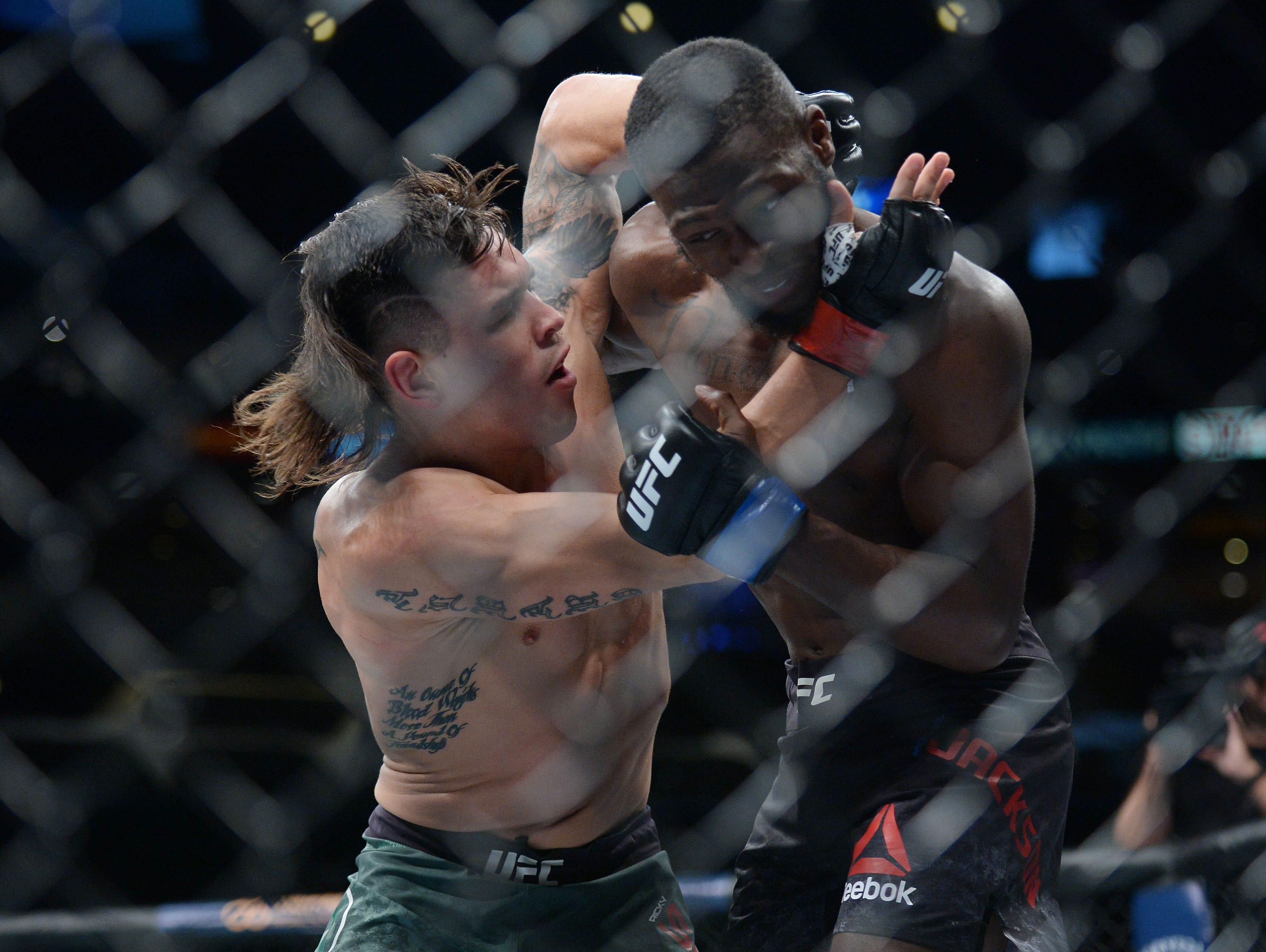 Ricky Simon moves in against Montel Jackson during UFC 227 at Staples Center.