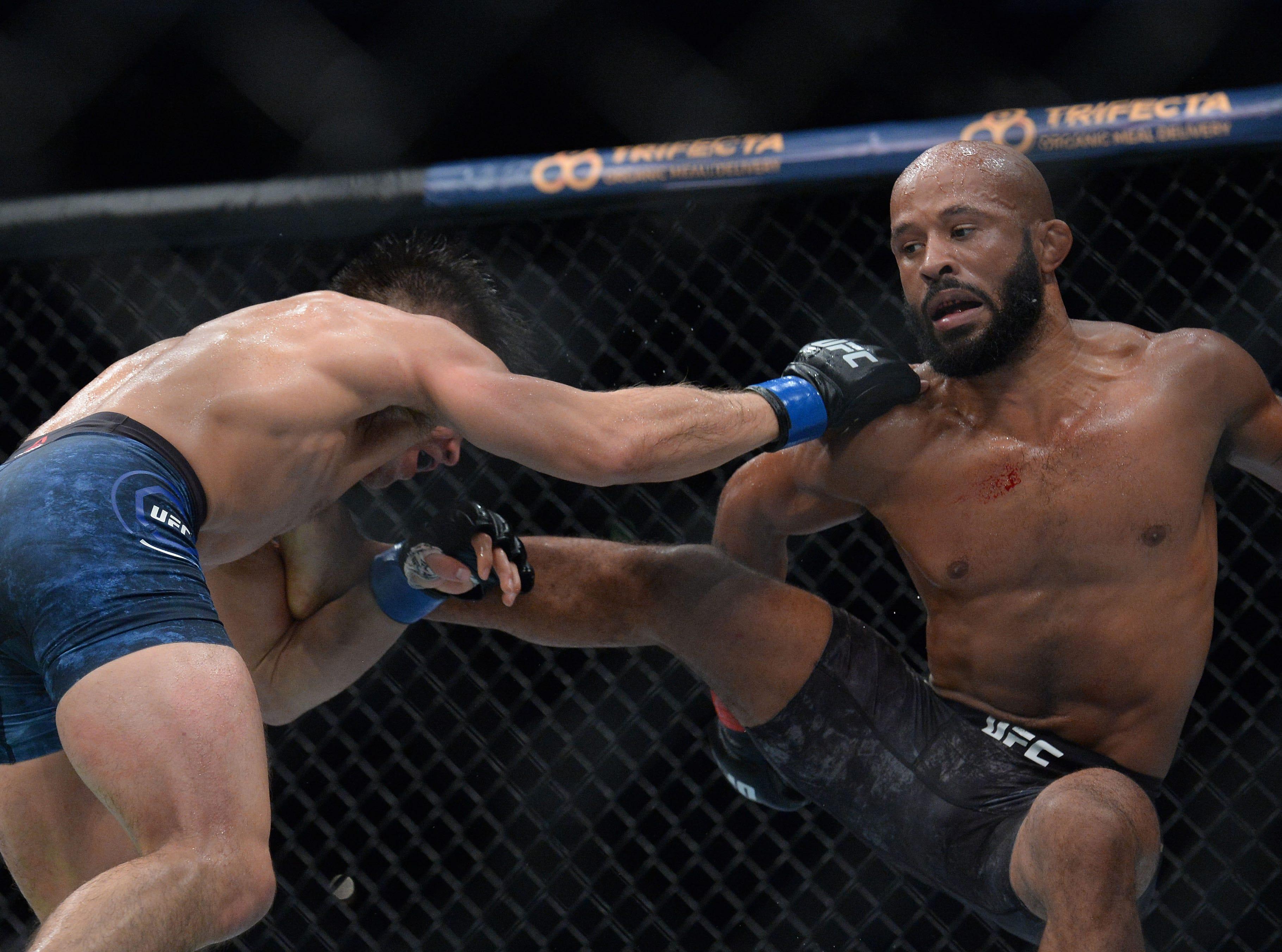 Henry Cejudo moves in against Demetrious Johnson during UFC 227 at Staples Center.