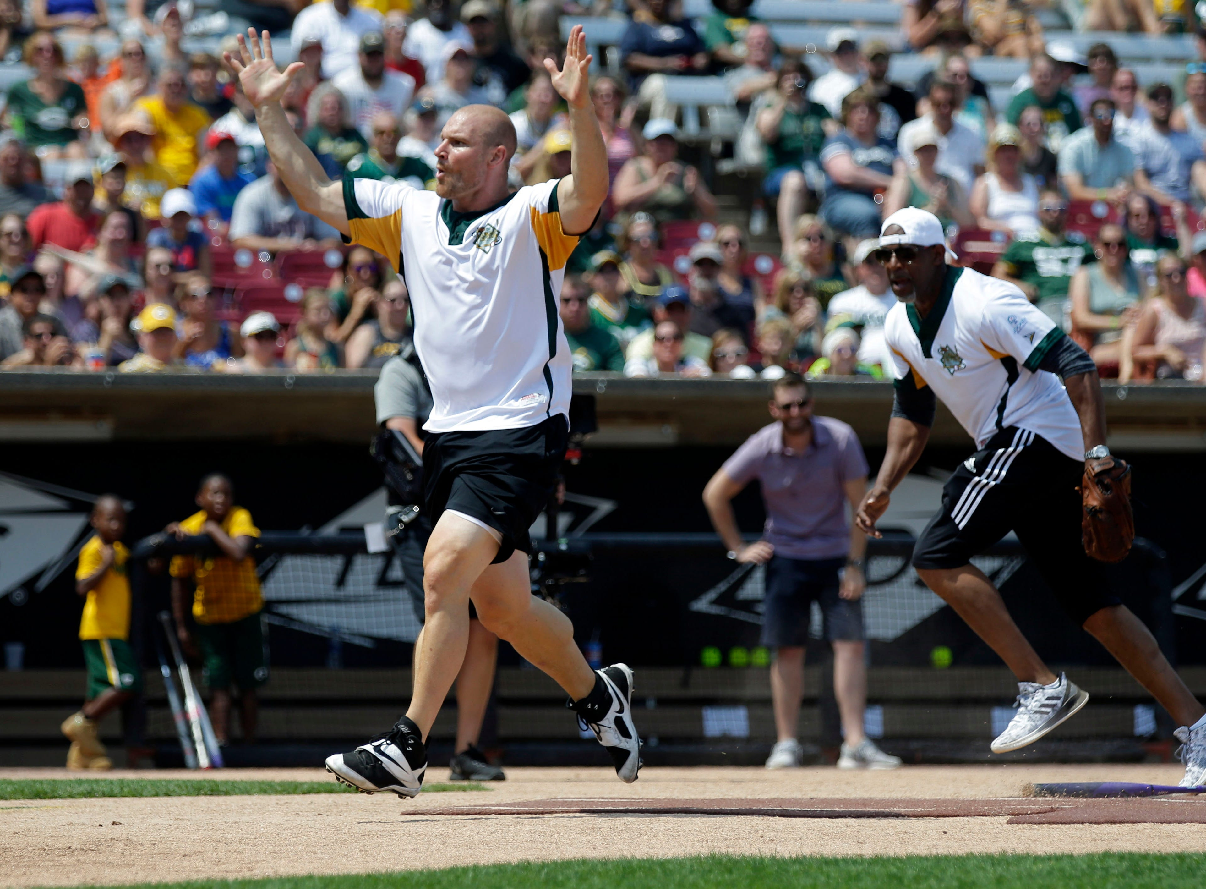 Brady Poppinga celebrates a run as Donald Driver and a few of his friends gather for a charity softball game Sunday, August 5, 2018, at Neuroscience Group Field at Fox Cities Stadium in Grand Chute, Wis.