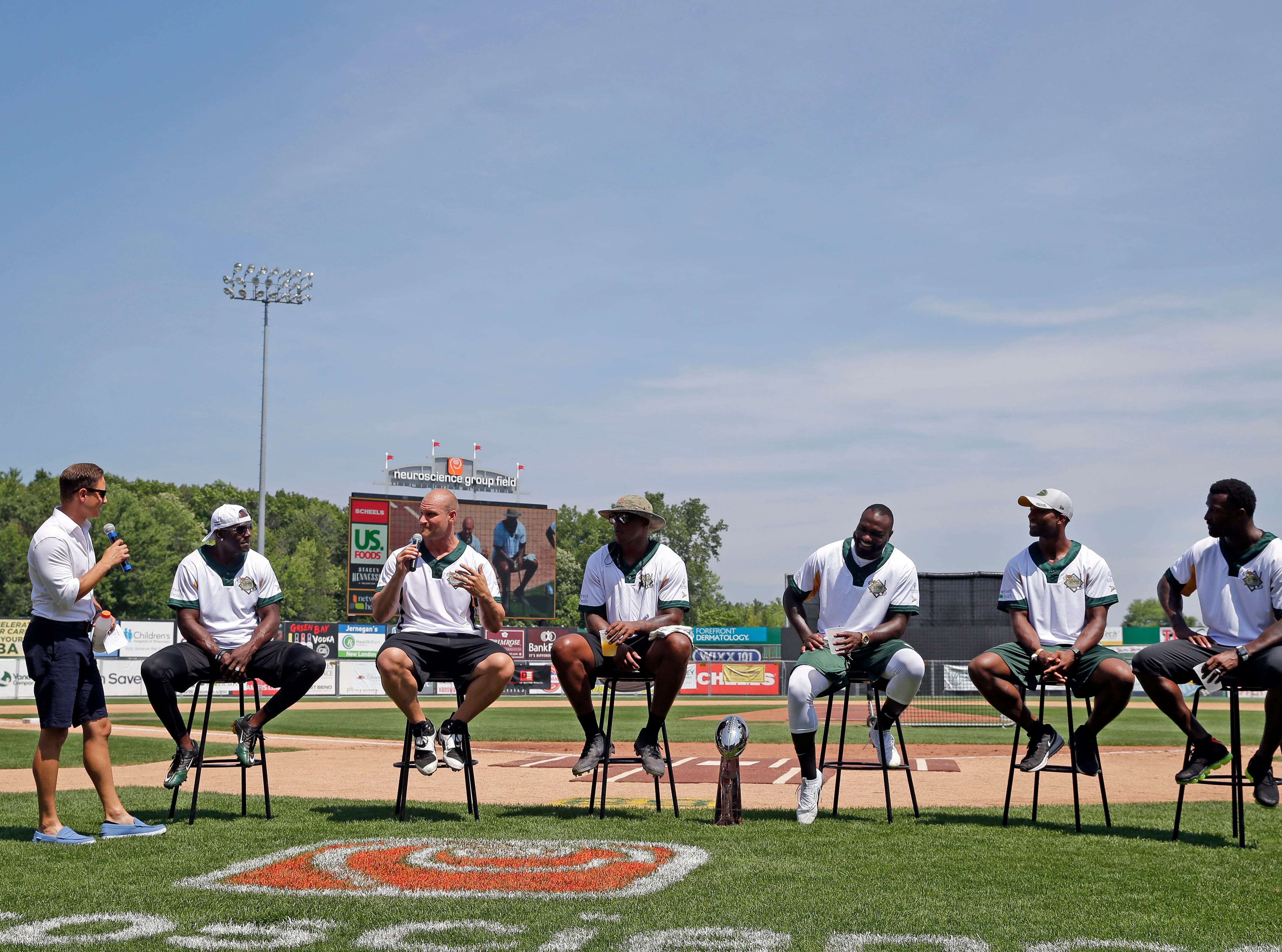 Members of the Packers that played in Super Bowl XLV talk before the Donald Driver charity softball game Sunday, August 5, 2018, at Neuroscience Group Field at Fox Cities Stadium in Grand Chute, Wis.