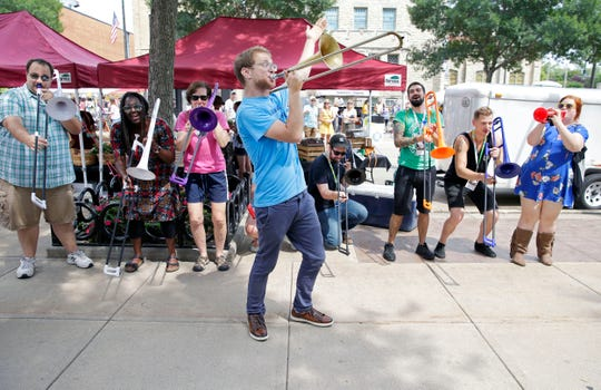 Ilan Blanck of Porky's Groove Machine directs participants in a Funk Band Jam during the recent Mile of Music festival in Appleton. Ron Page/USA TODAY NETWORK-Wisconsin