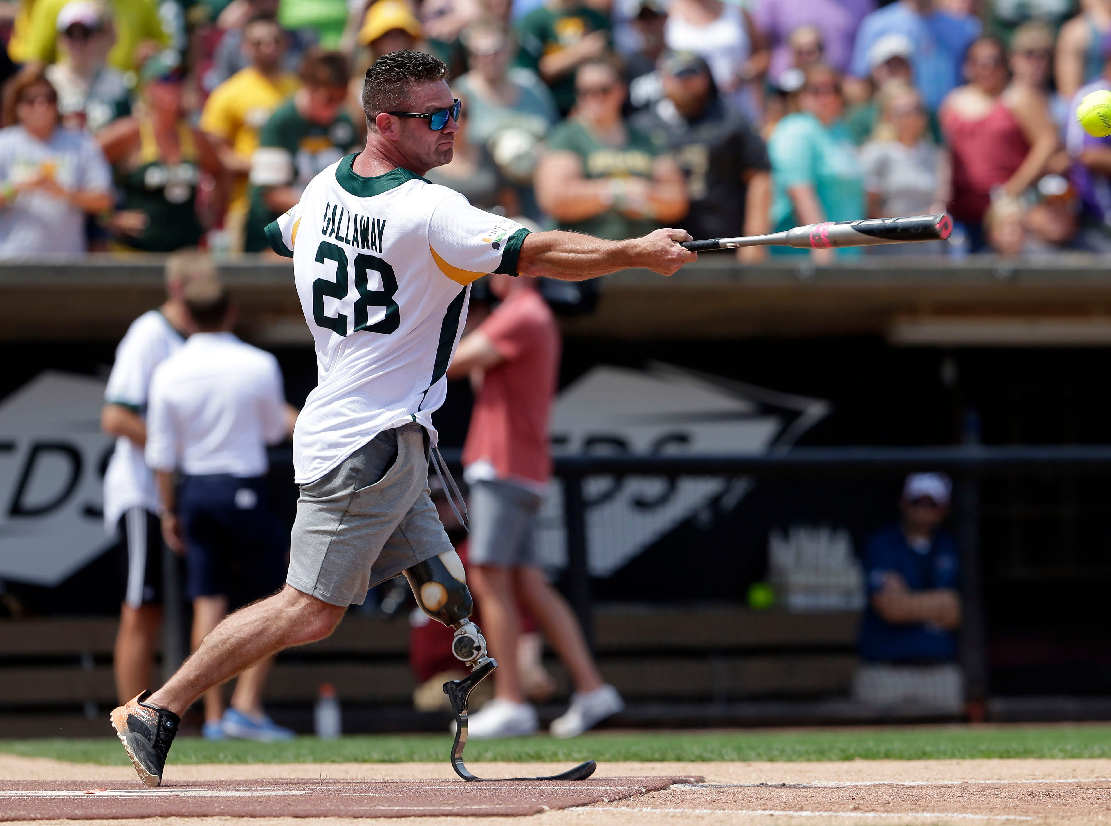 Noah Galloway bats as Donald Driver and a few of his friends gather for a charity softball game Sunday, August 5, 2018, at Neuroscience Group Field at Fox Cities Stadium in Grand Chute, Wis.