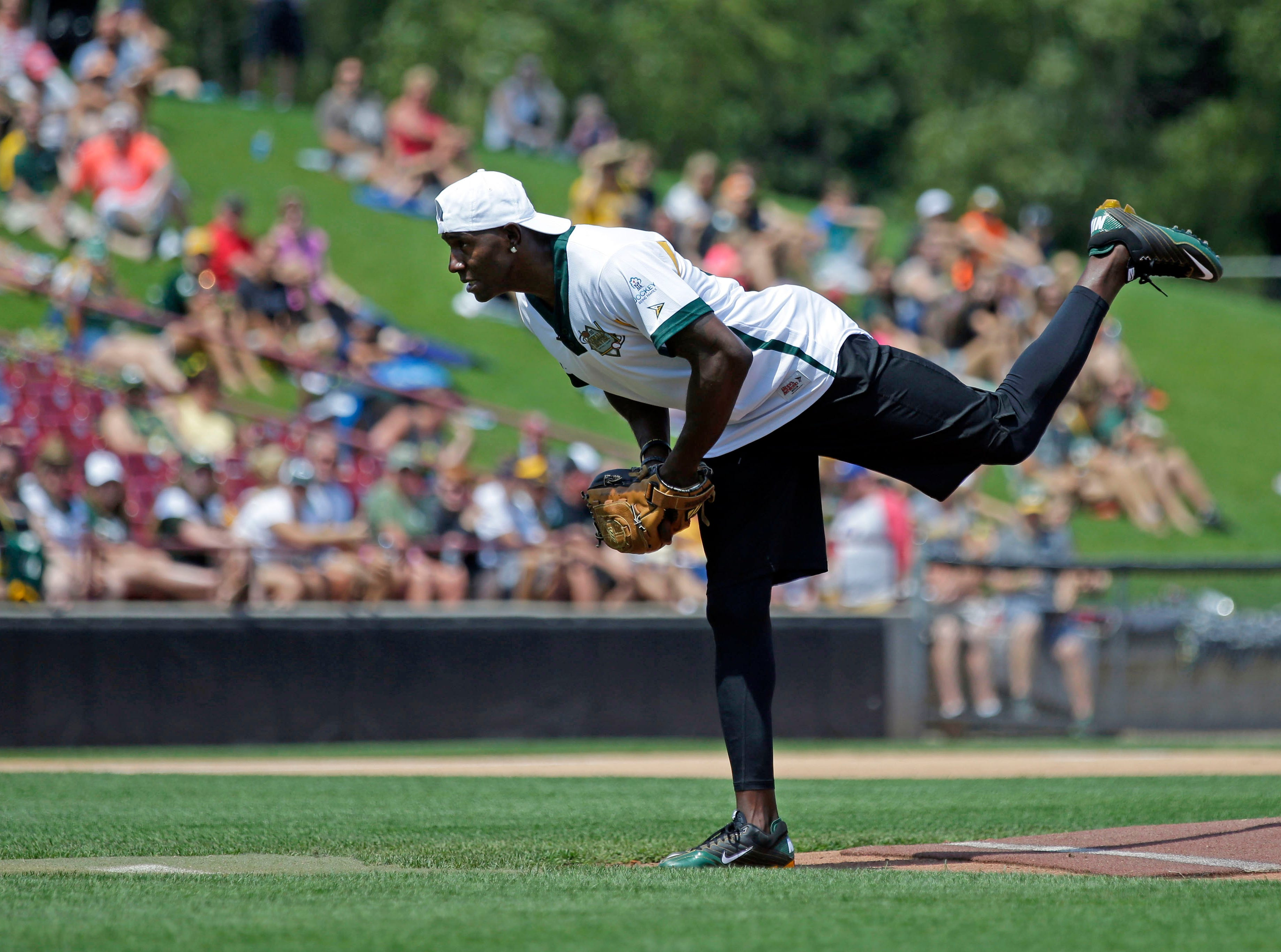 Donald Driver shows his pitching form as a few of his friends gather for a charity softball game Sunday, August 5, 2018, at Neuroscience Group Field at Fox Cities Stadium in Grand Chute, Wis.