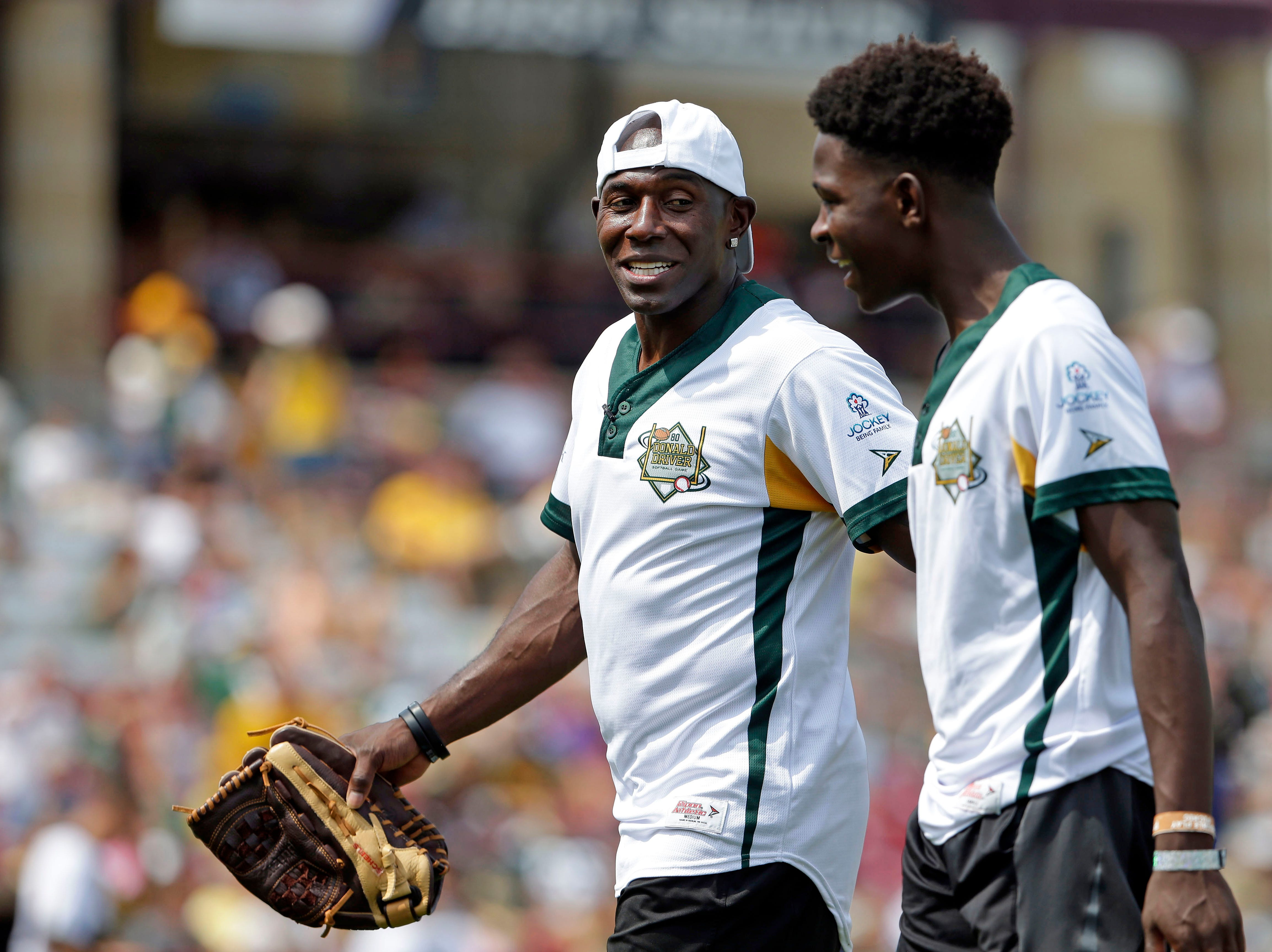 Donald Driver and his family are joined by friends for a charity softball game Sunday, August 5, 2018, at Neuroscience Group Field at Fox Cities Stadium in Grand Chute, Wis.