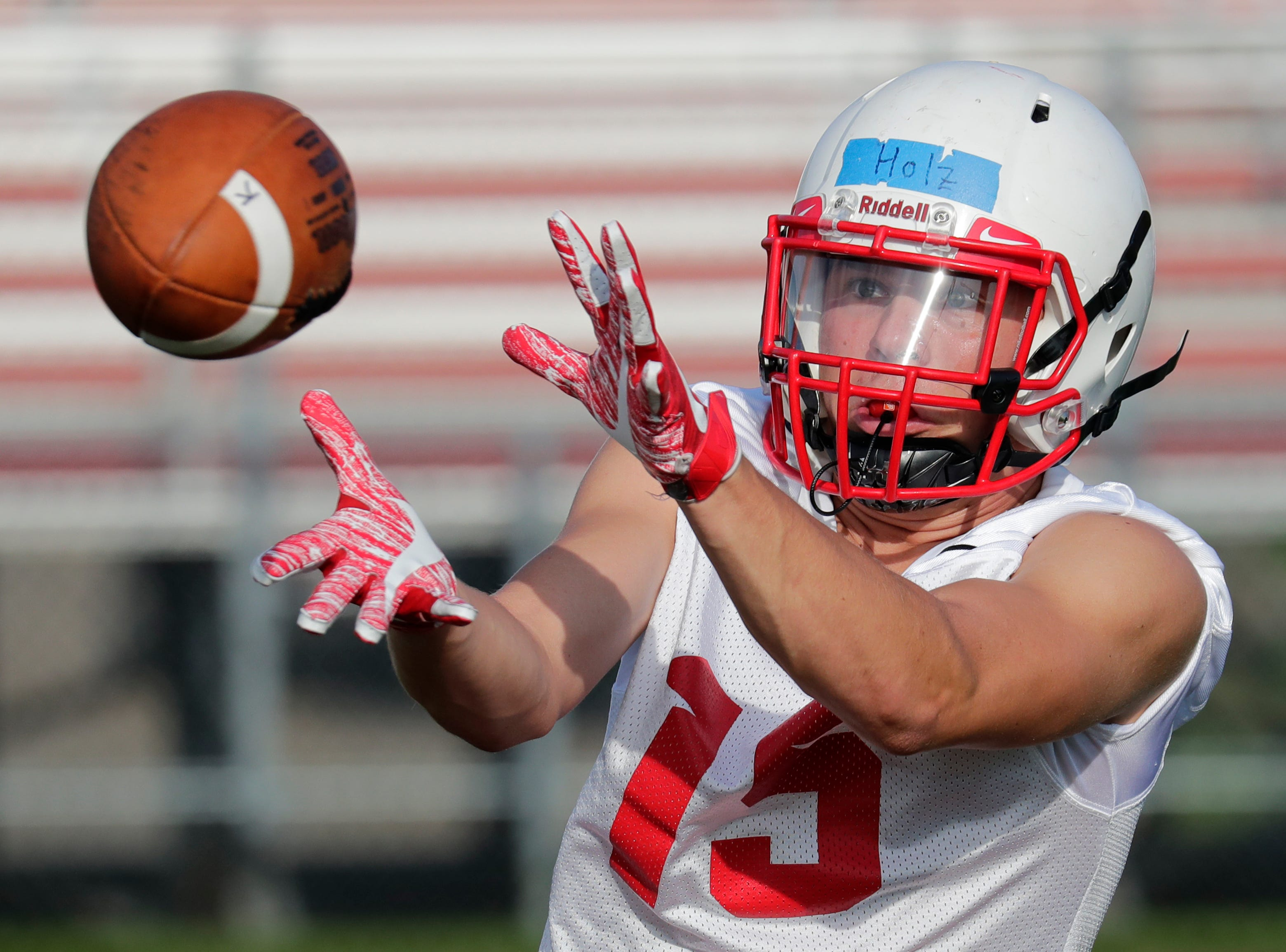 Trenton Holz pulls down a reception during the Kimberly High School football practice Wednesday, August 1, 2018, at Papermaker Stadium in Kimberly, Wis. 