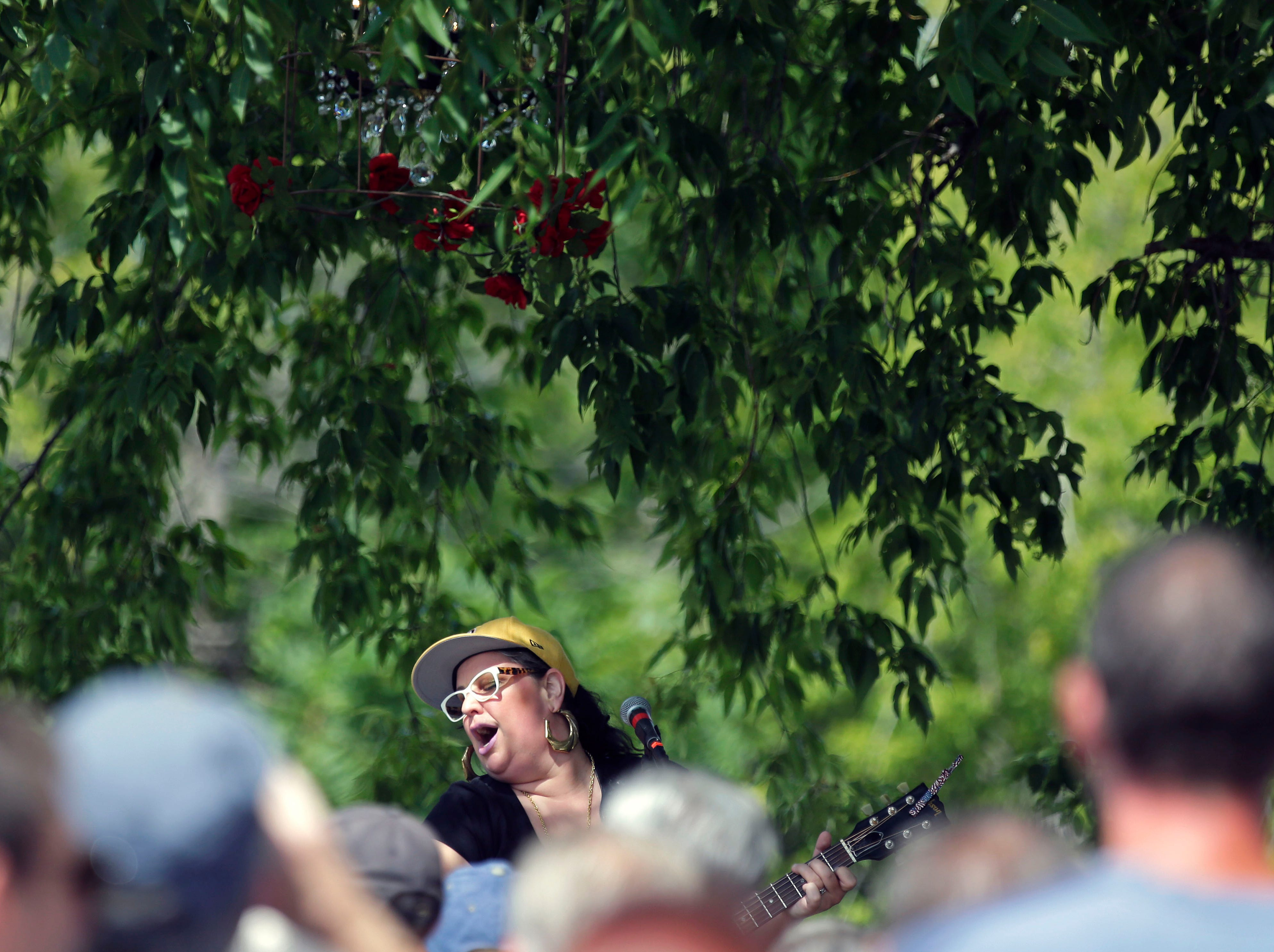 Sarah Potenza draws an early crowd to Fox River House as Mile 6, the Mile of Music festival comes to a close Sunday, August 5, 2018, in Appleton, Wis.