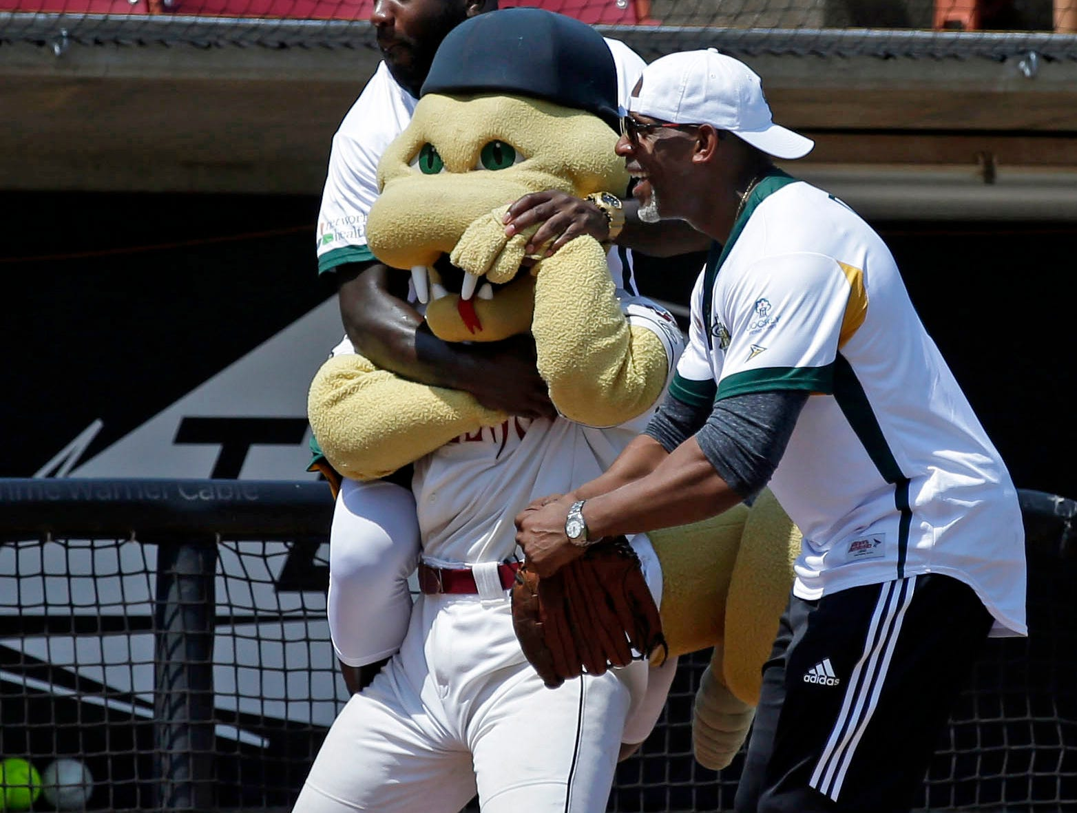 Fang engages in hijinks during the Donald Driver charity softball game Sunday, August 5, 2018, at Neuroscience Group Field at Fox Cities Stadium in Grand Chute, Wis.