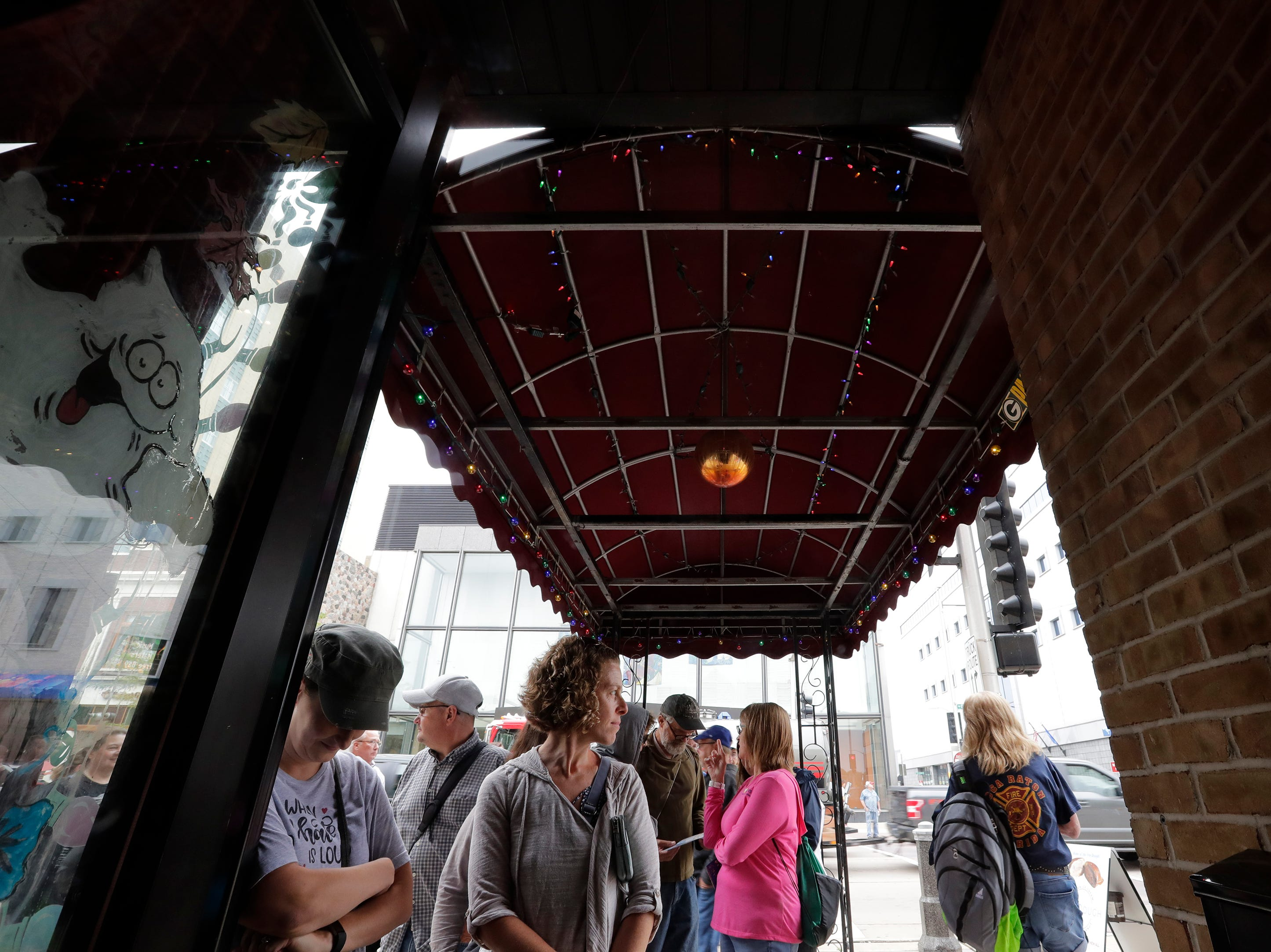 Music fans wait in line to here a performance at Cleo's Brown Beam Tavren during the Mile of Music Thursday, August 2, 2018, in Appleton, Wis.  