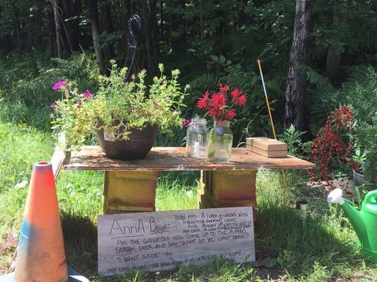 """A memorial at the crash site where Burlington resident Annabelle Robert, 25, was killed on Aug. 3, 2018, says, """"One love people. See each other. If no one told you today, I love you."""""""