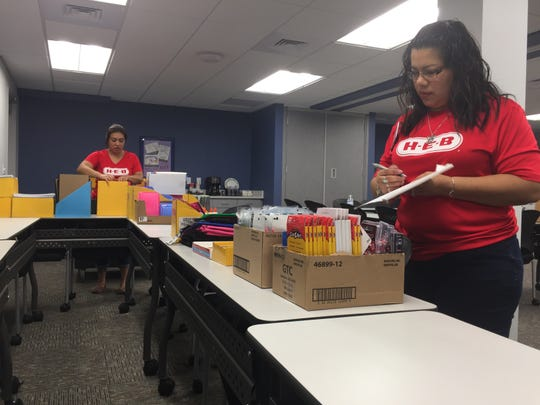 Tanya Aguero and Soila Whitaker count supplies donated from local businesses.
