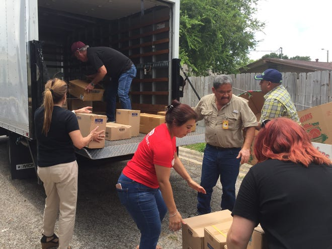 Volunteers load collected school supplies that will go to Tuloso-Midway schools this fall.
